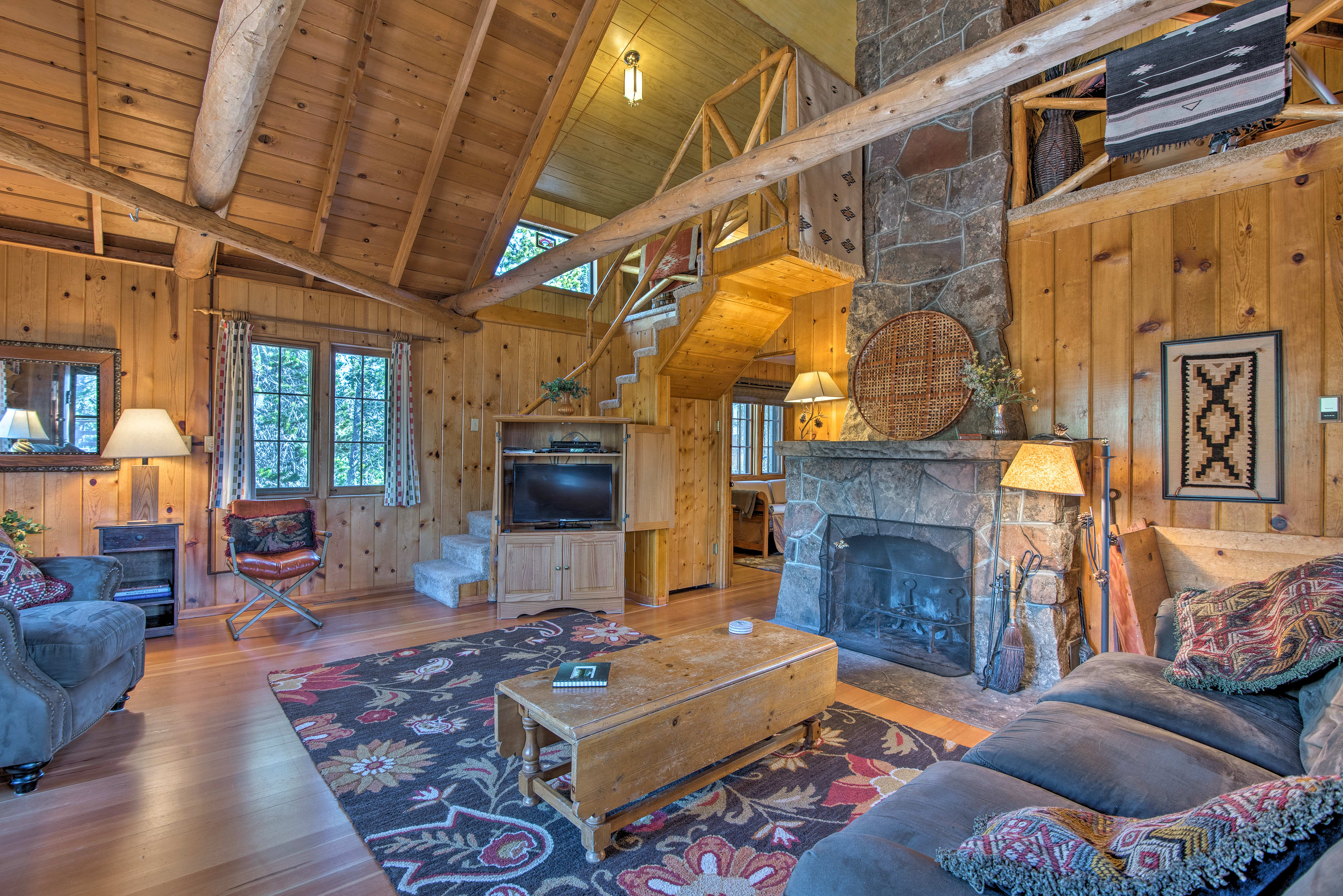 This spacious home boasts a warm cabin ambiance.