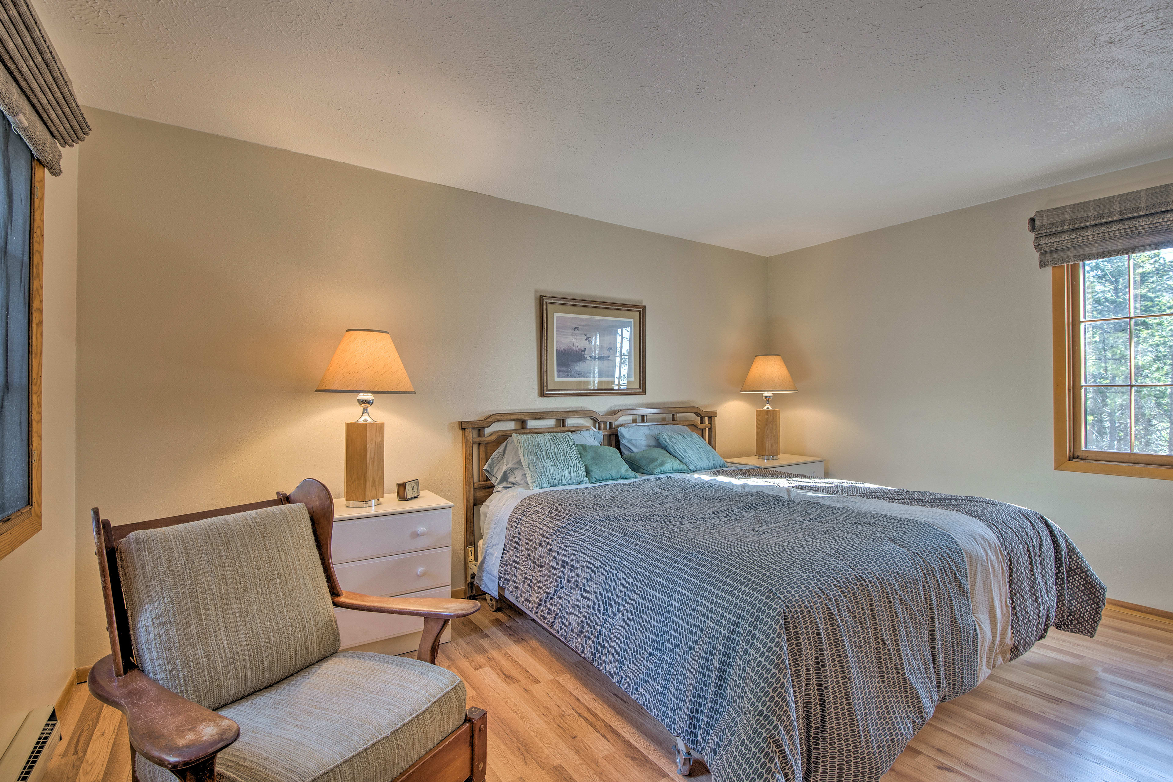 Curl up on the master bedroom's cozy king bed.