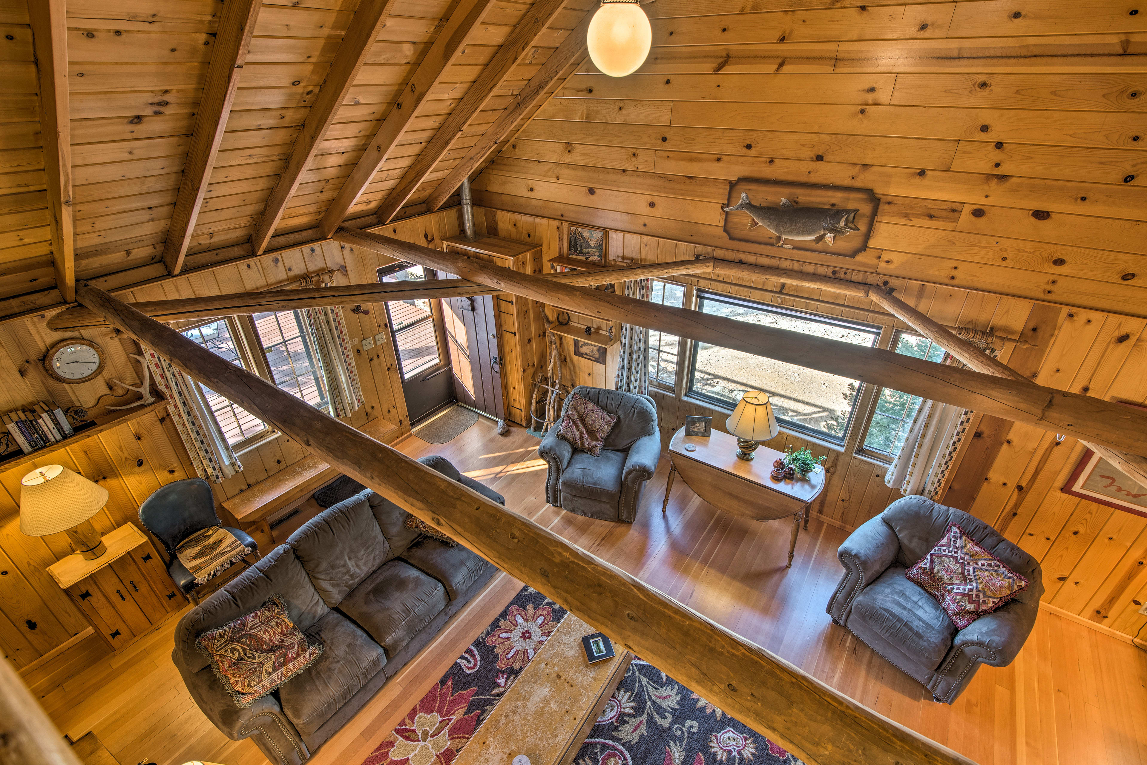Enjoy a bird's-eye view of the cabin from the loft.