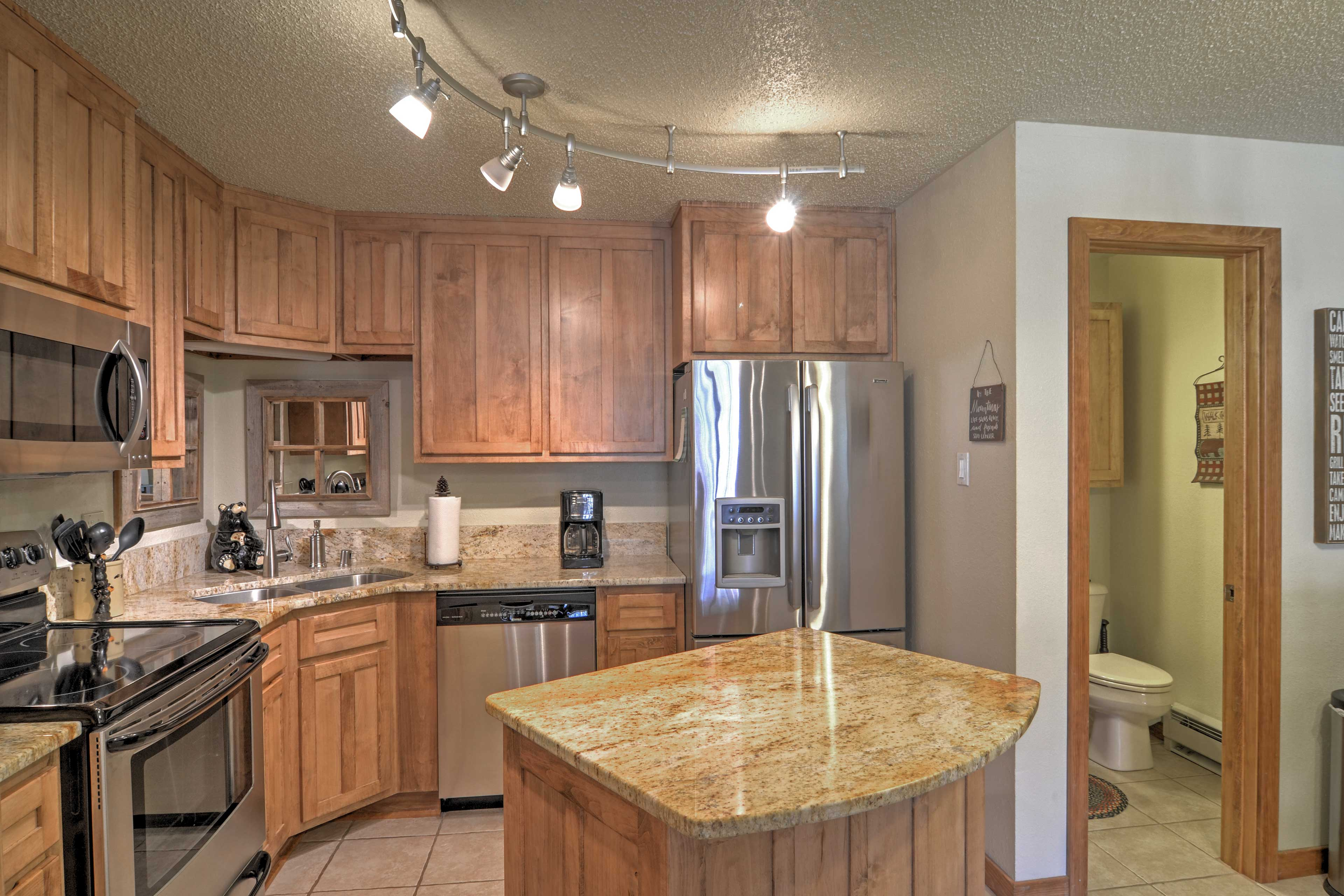 With granite counters and stainless steel appliance, cooking will be a breeze.