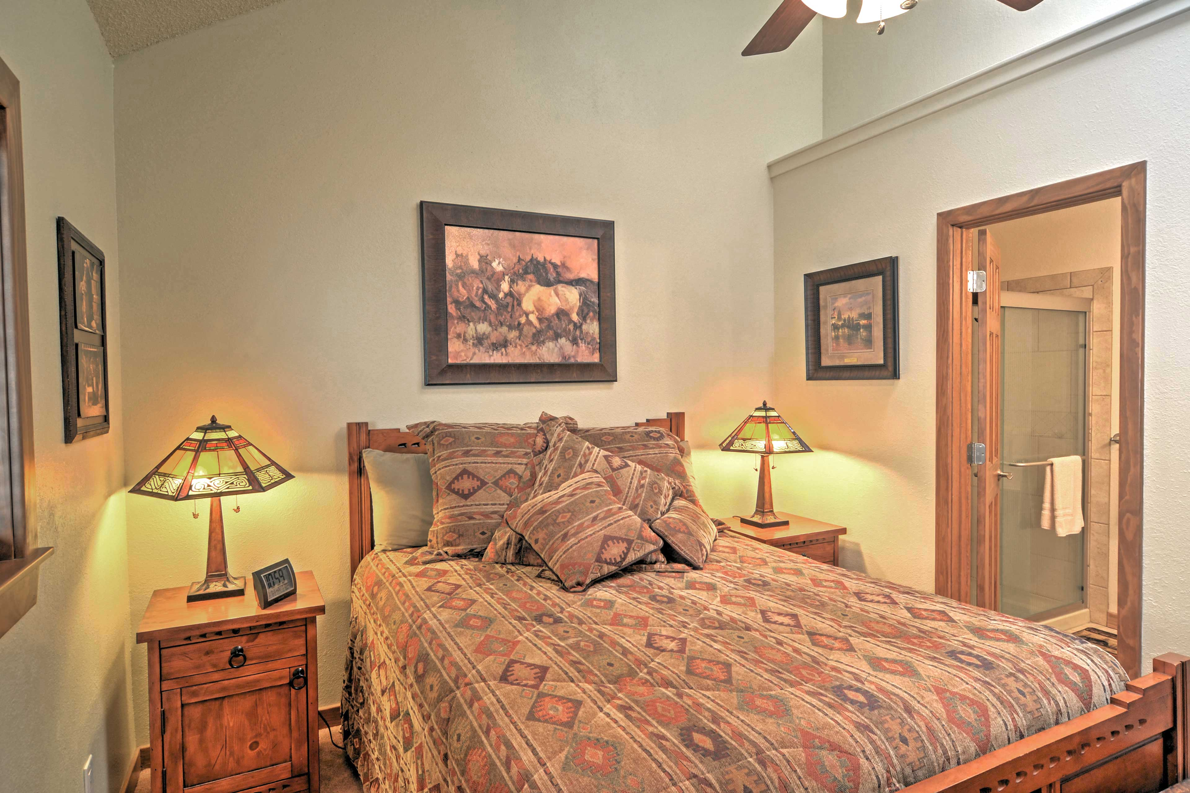 This second bedroom boasts a cozy queen bed.