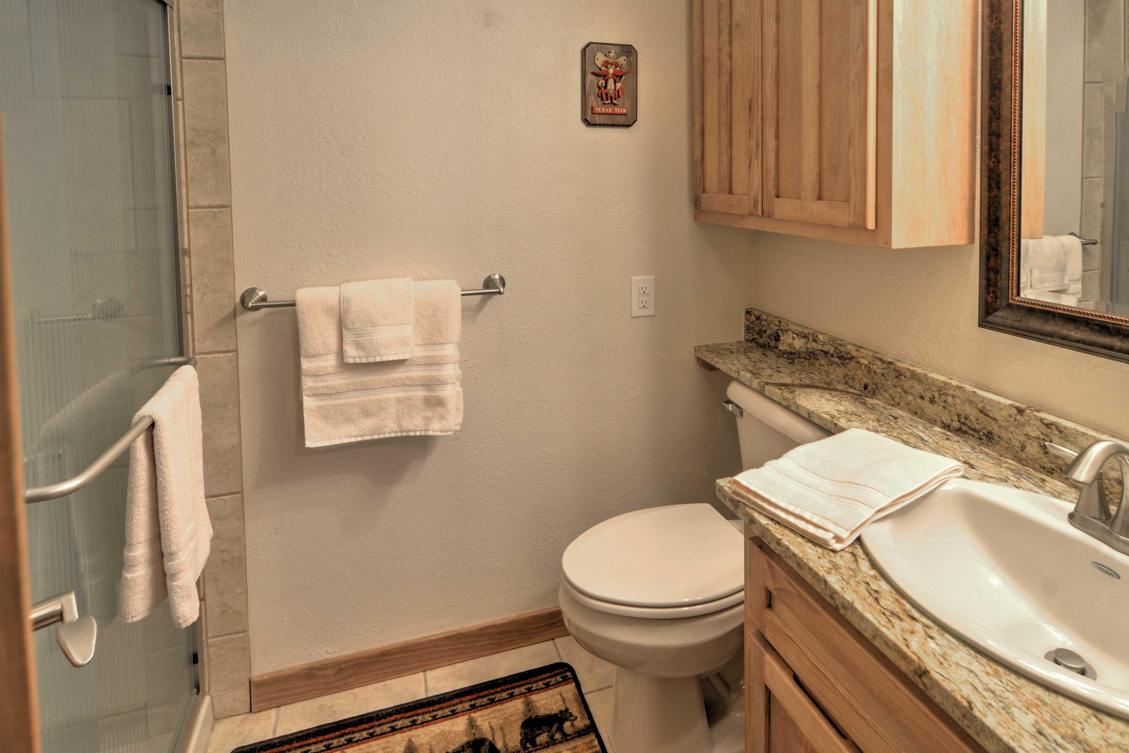 Freshen up in this pristine en-suite bathroom.