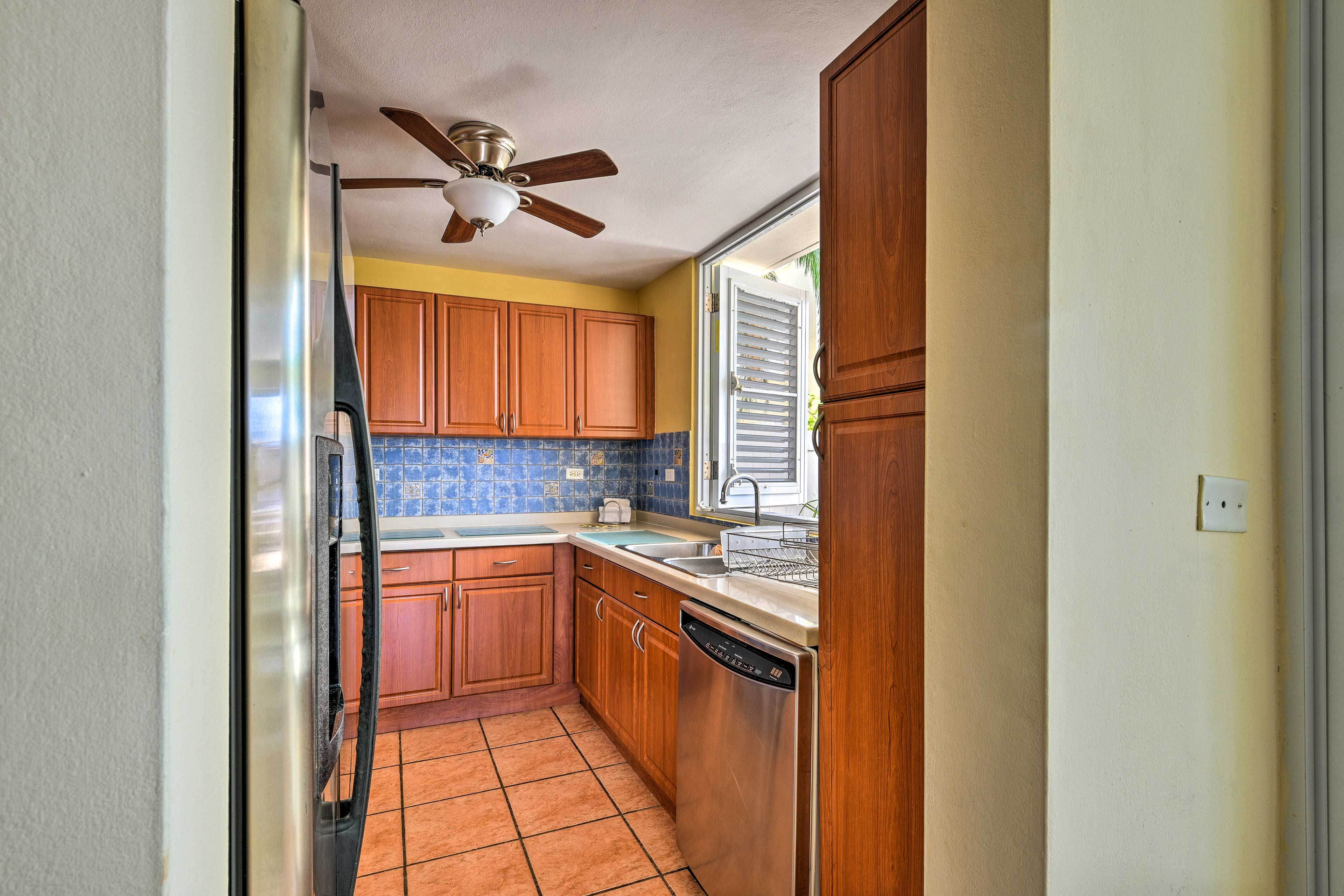 Begin meal preparations in the fully equipped kitchen.