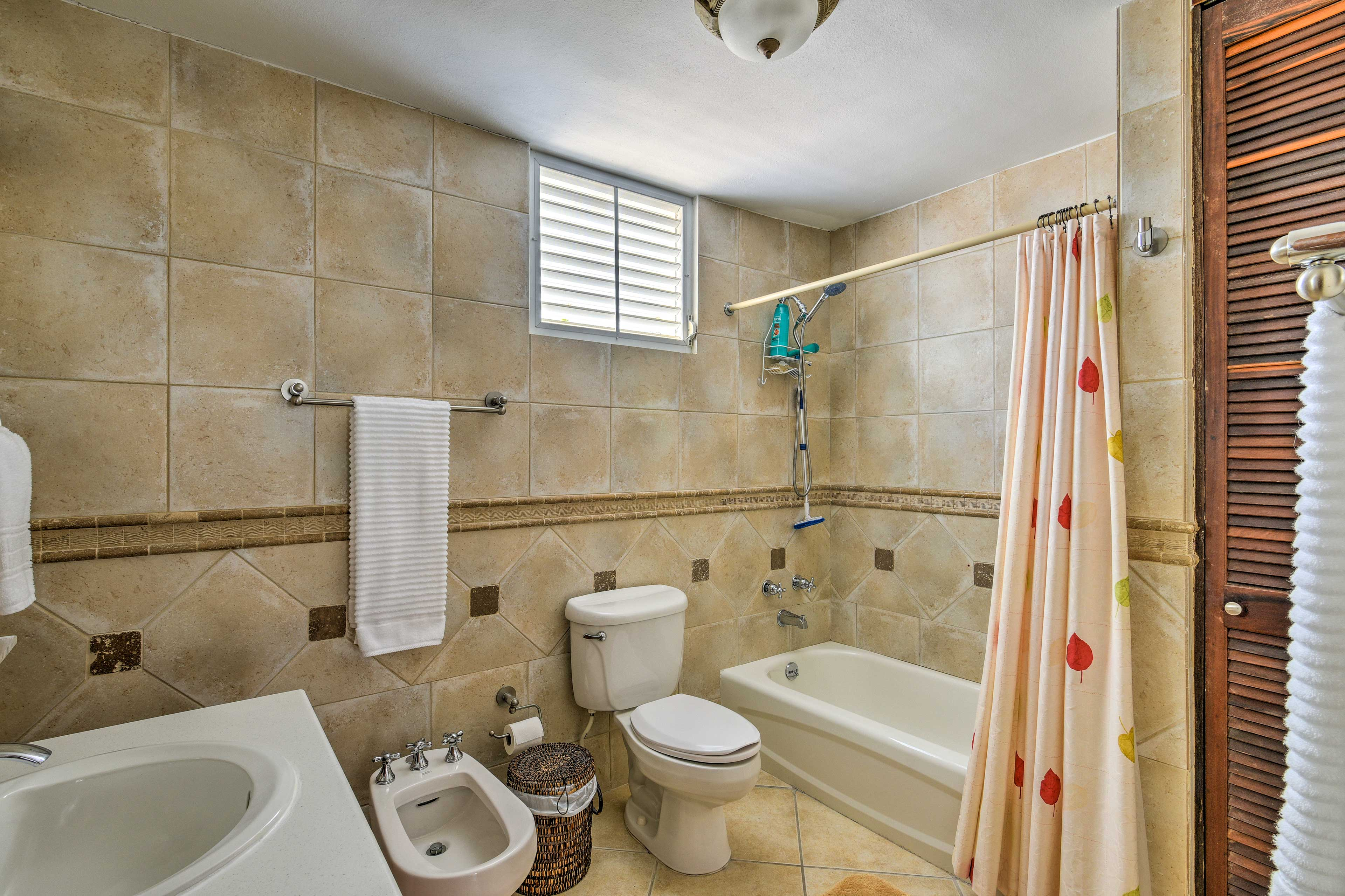 The master en-suite bathroom boasts a shower/tub combo.
