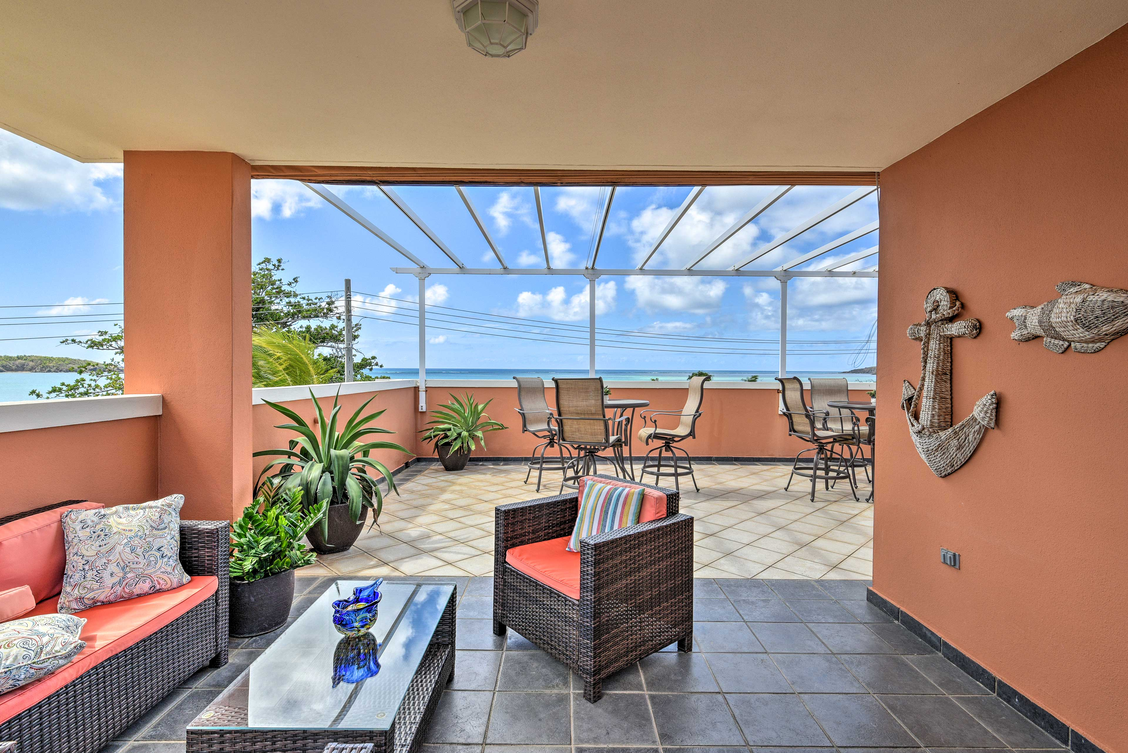 Nothing beats the third-floor terrace with a covered sitting area.