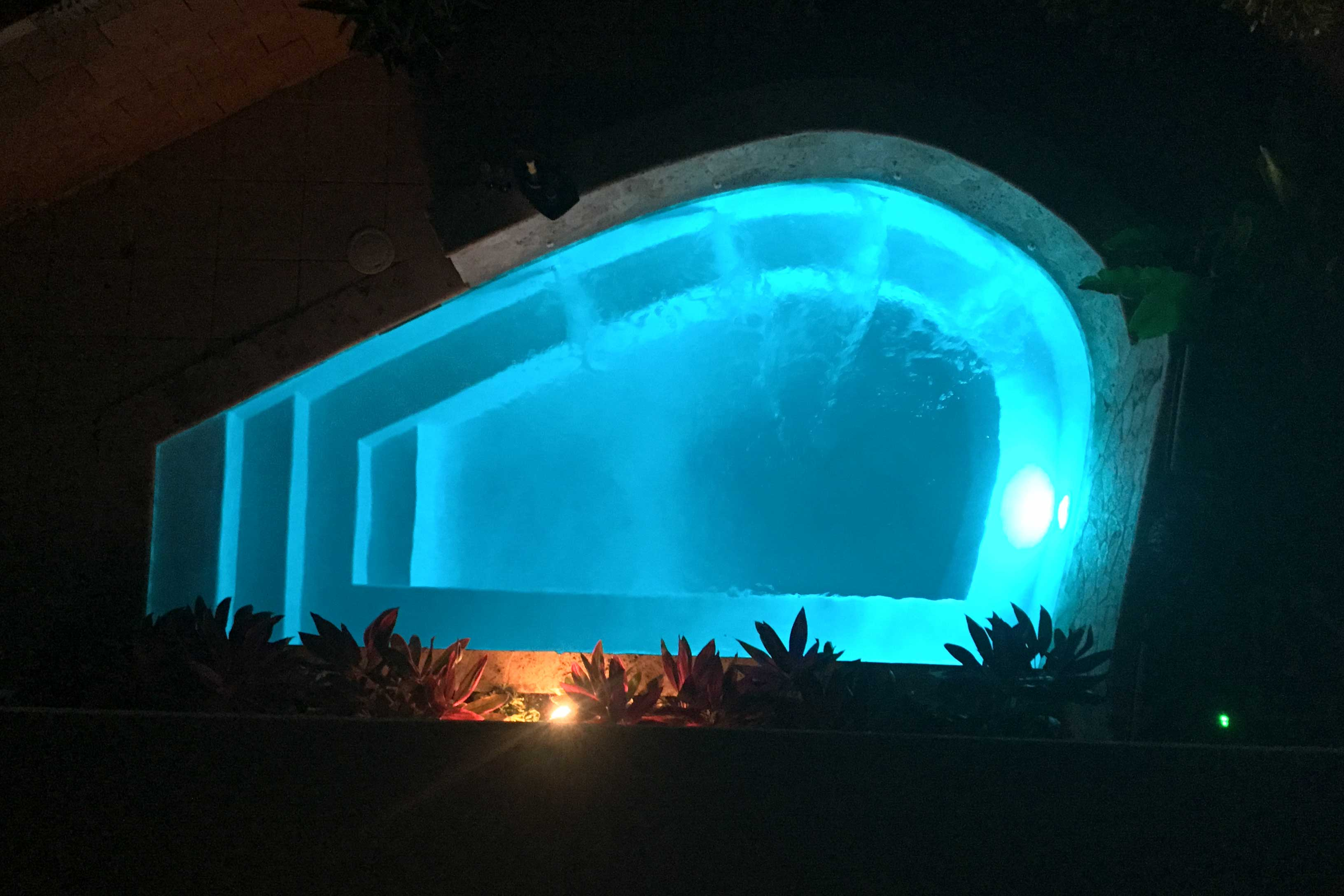 The pool is the place to be day or night!