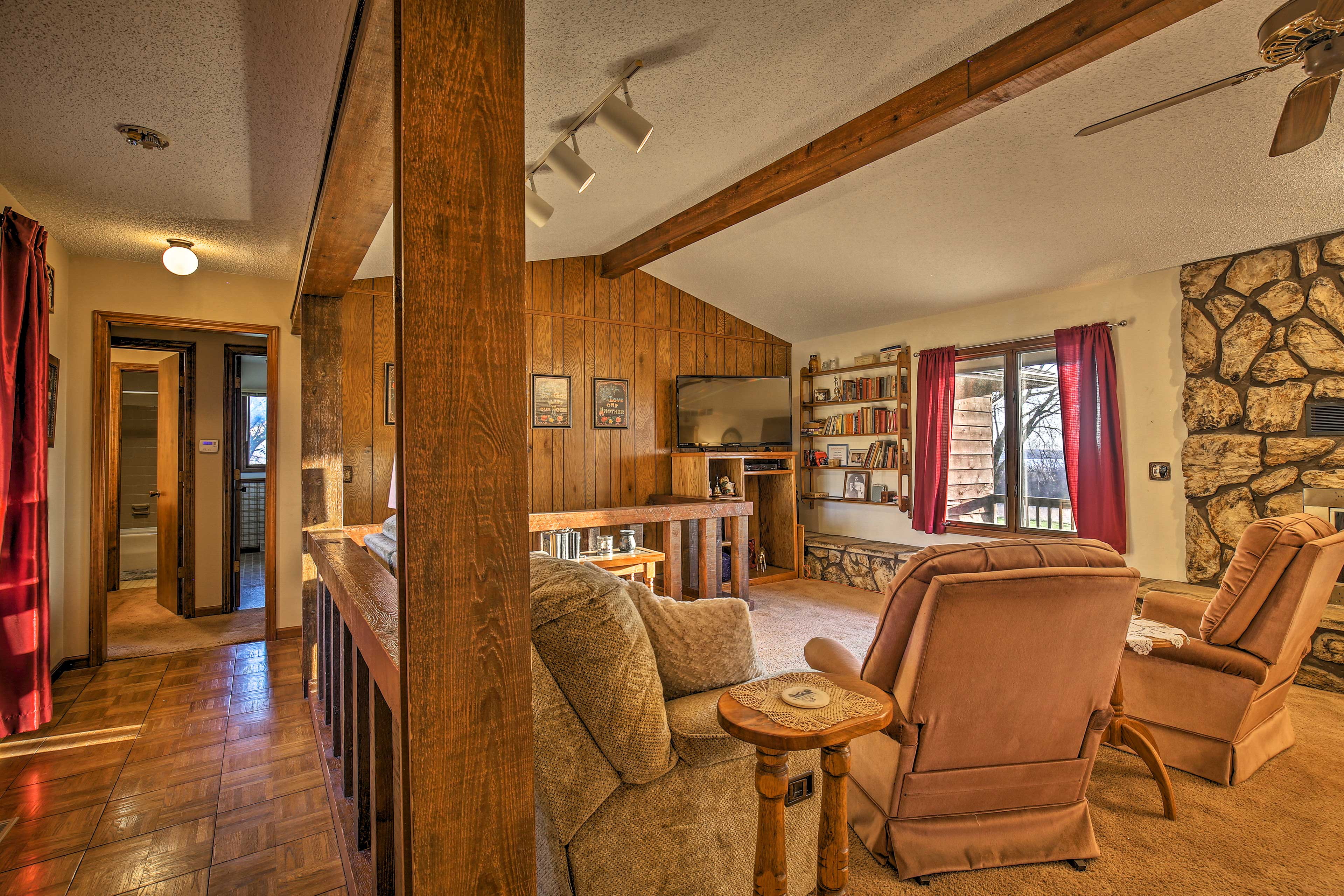 Comfortable seating makes it easy to unwind in this spacious retreat.