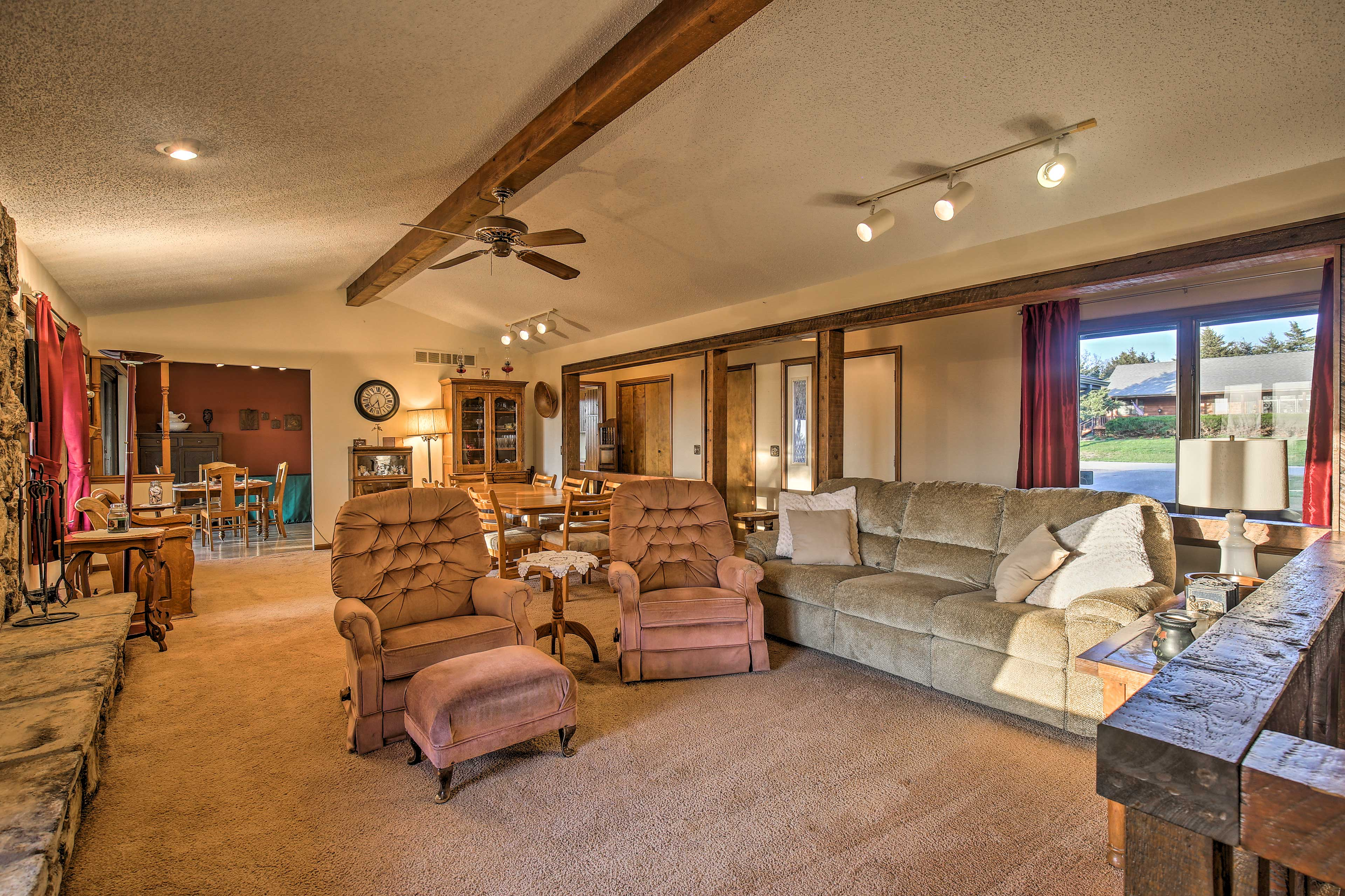 Enjoy the exposed beams, a floor-to-ceiling rock fireplace and water views.