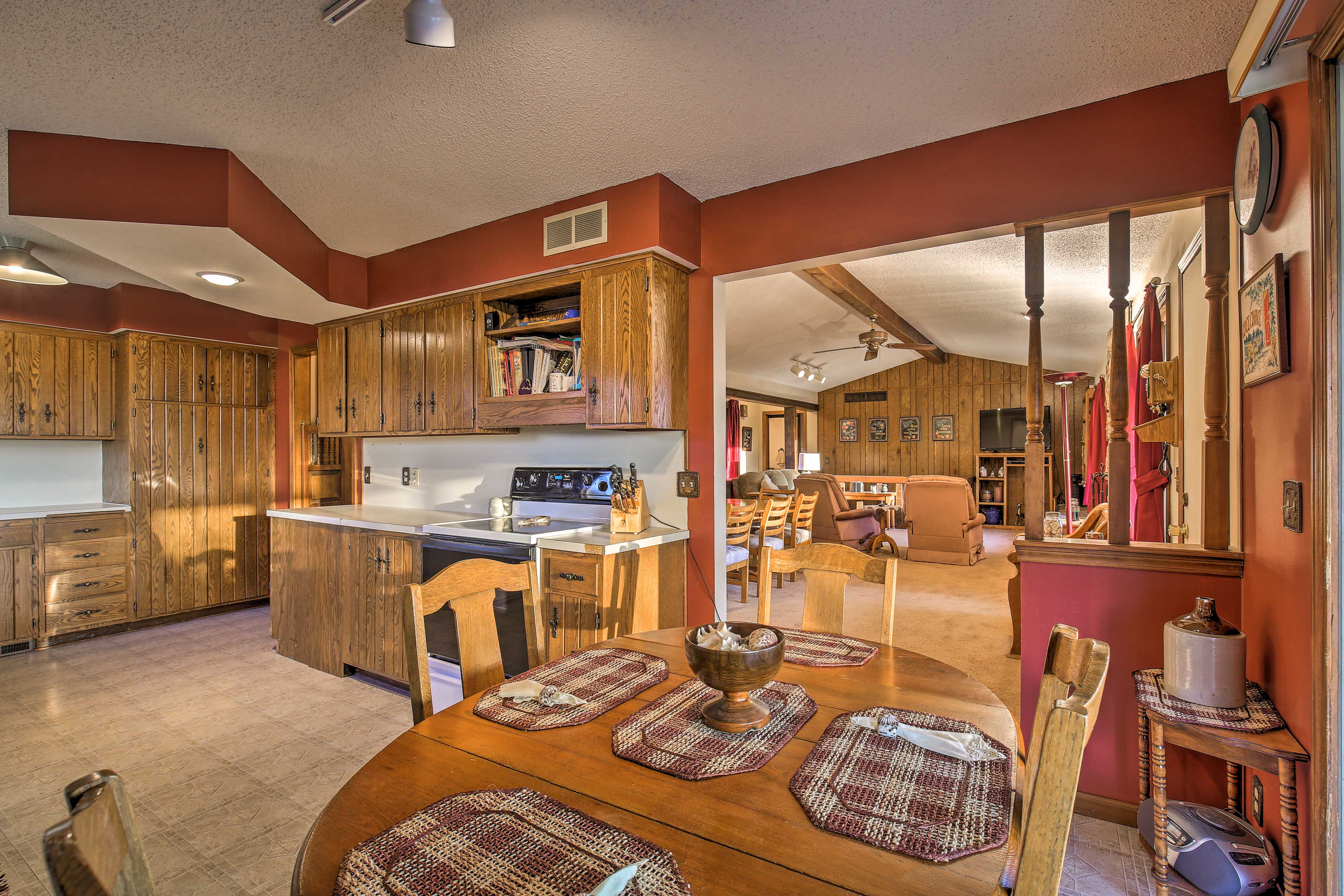 Step into the spacious fully equipped kitchen to prepare your meals.