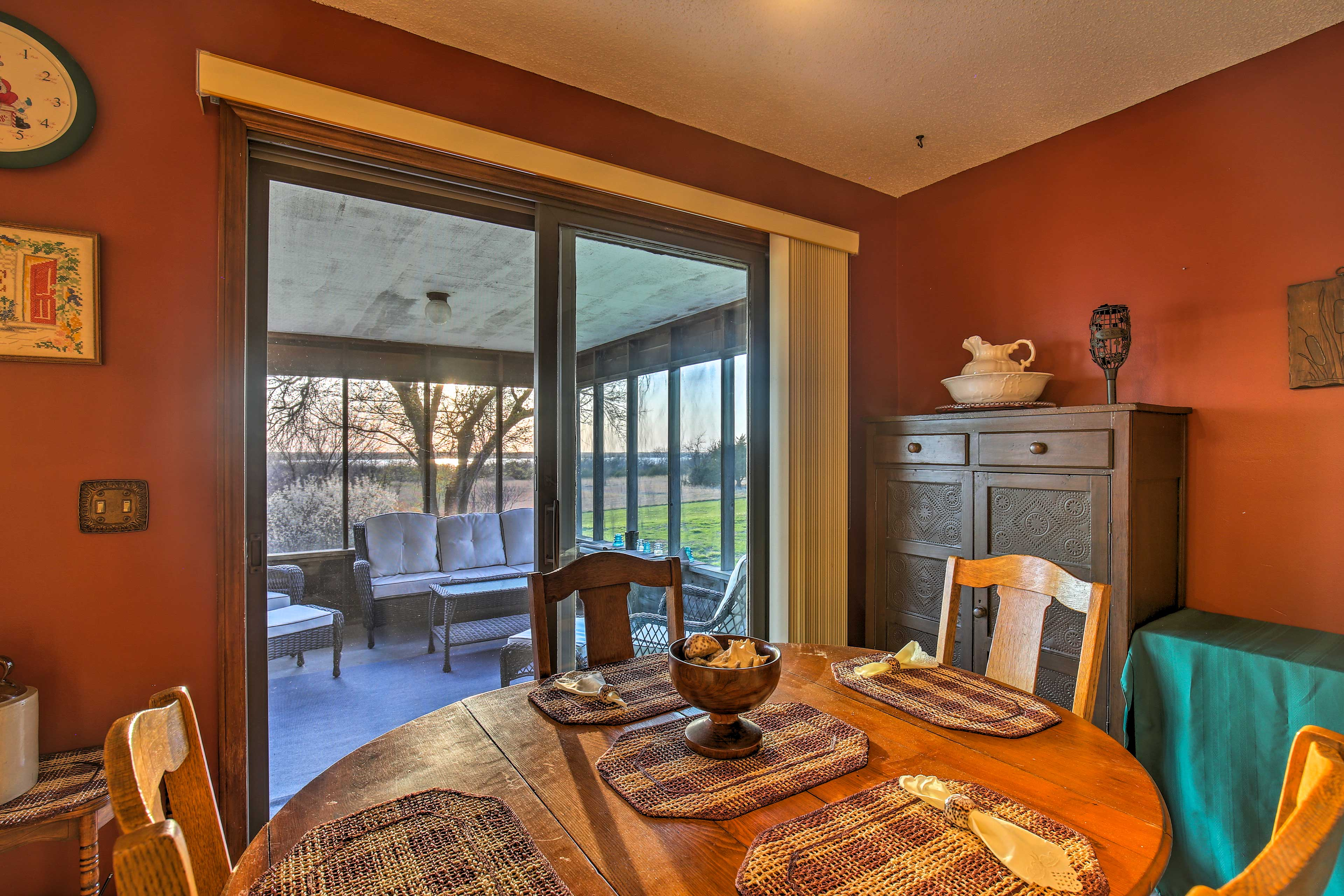 Dine at the 4-person kitchen table as natural light floods in the glass doors.