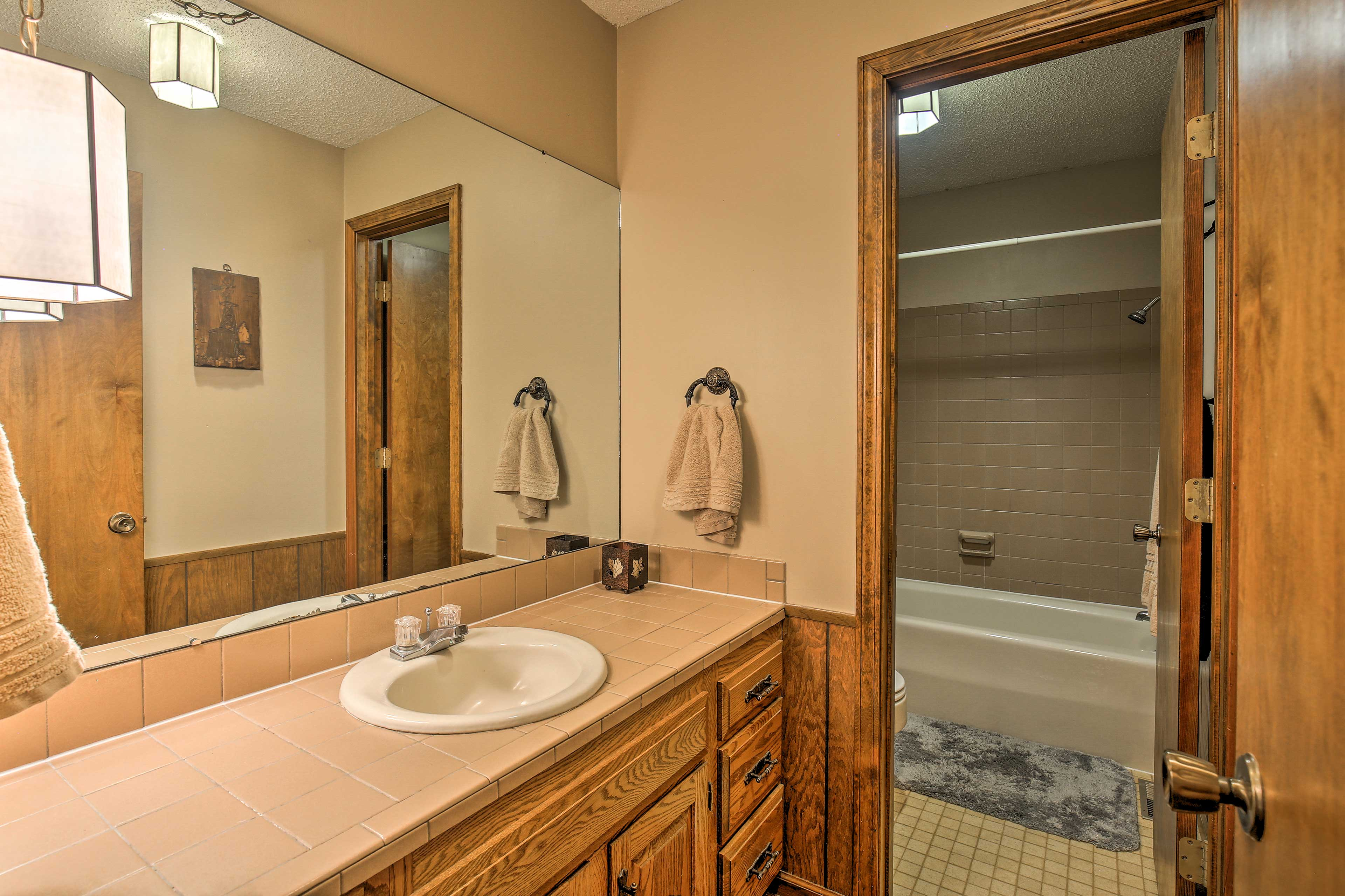 A full bathroom is located just down the hallway for your convenience.
