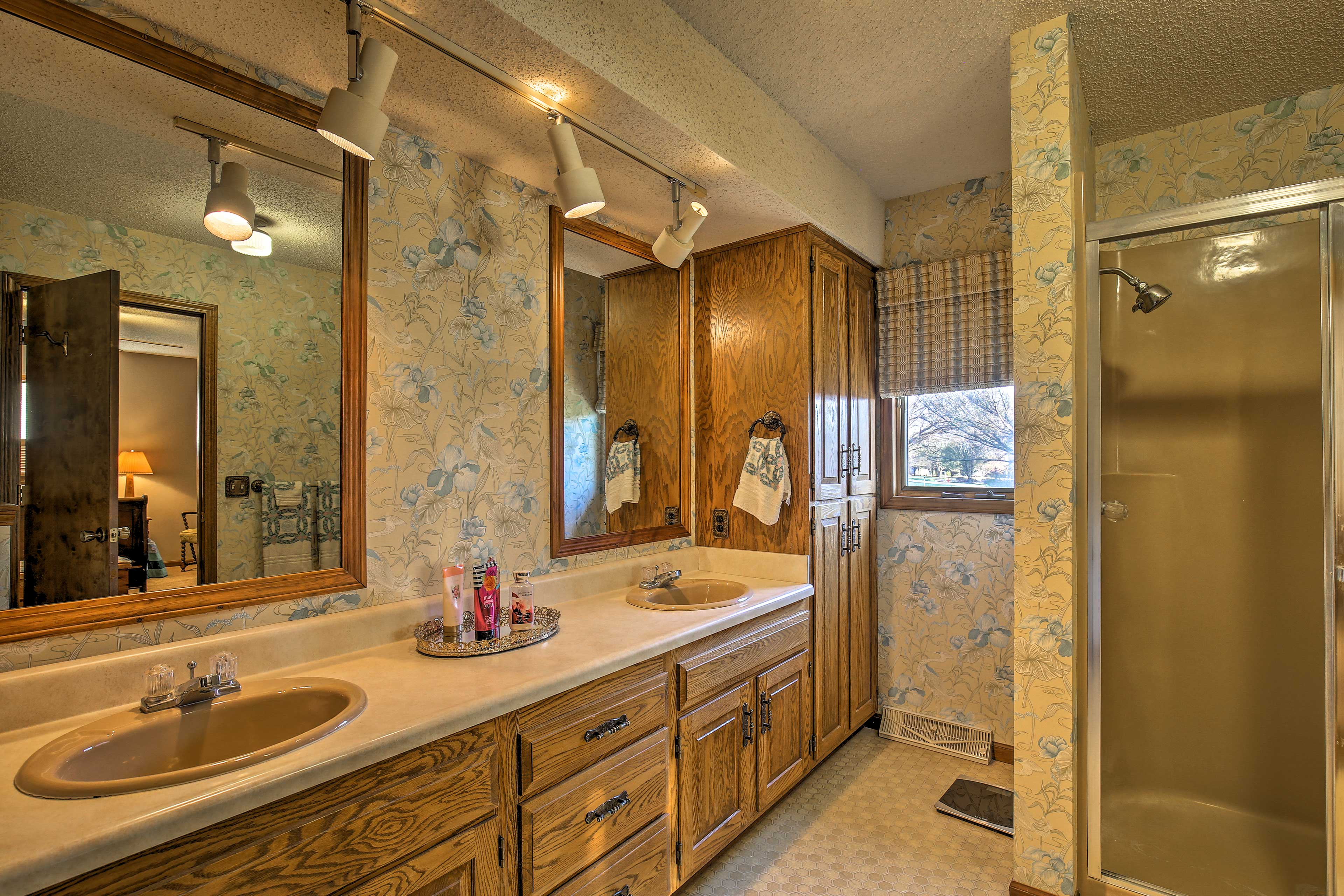 The master bathroom features double sinks and a walk-in shower.