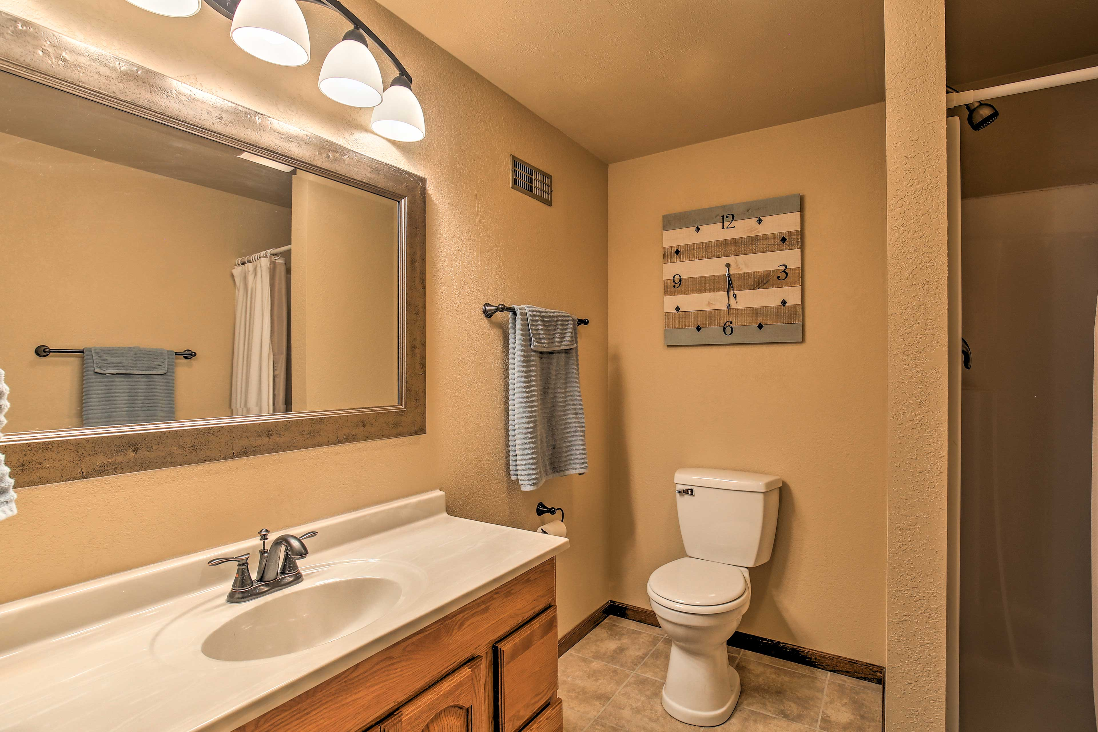 The lower level also has a full bathroom with a walk-in shower.