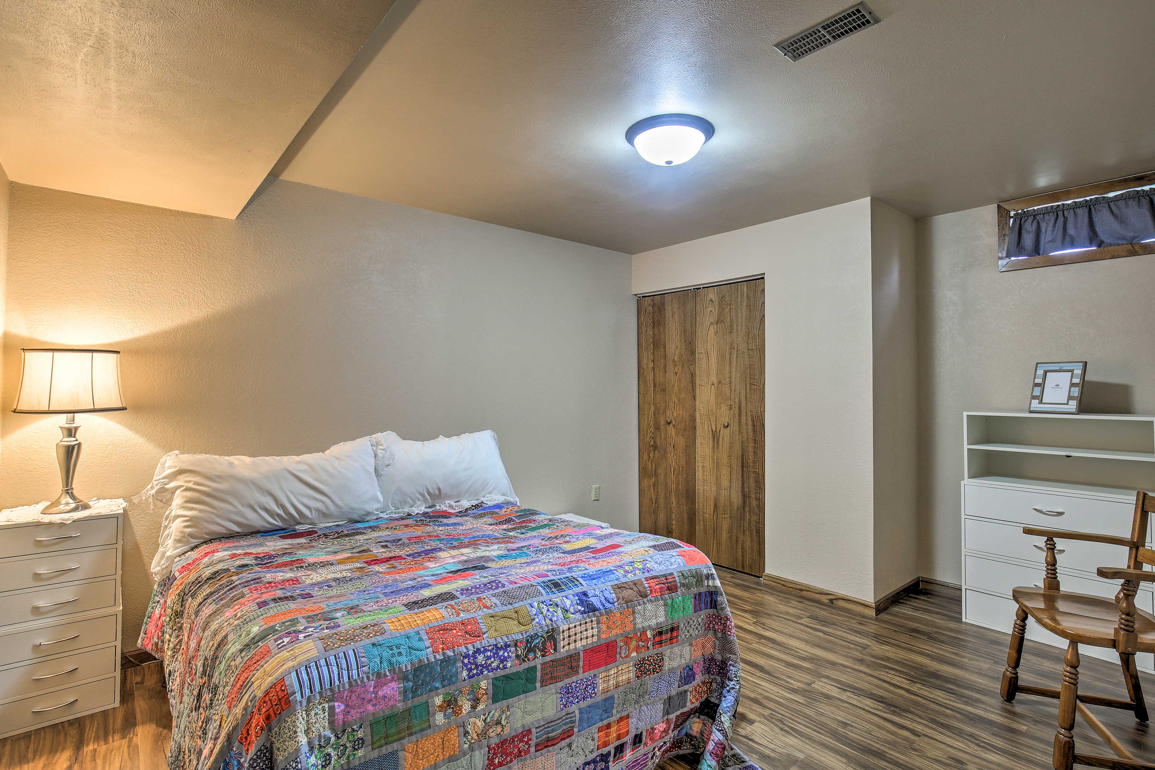 Doze off in the comfortable queen bed in the fourth bedroom.