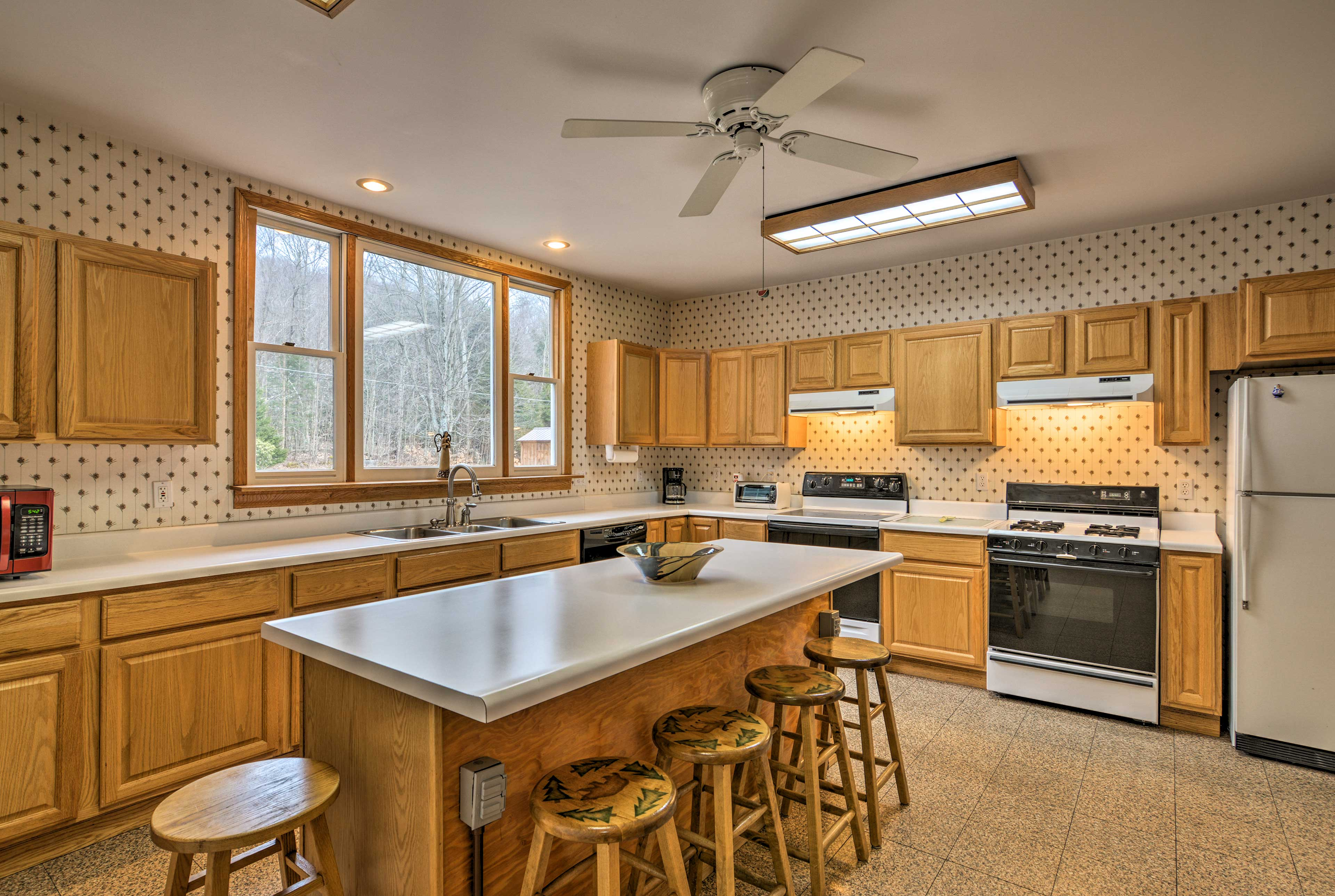 Step into the fully equipped kitchen to make your favorite meals.