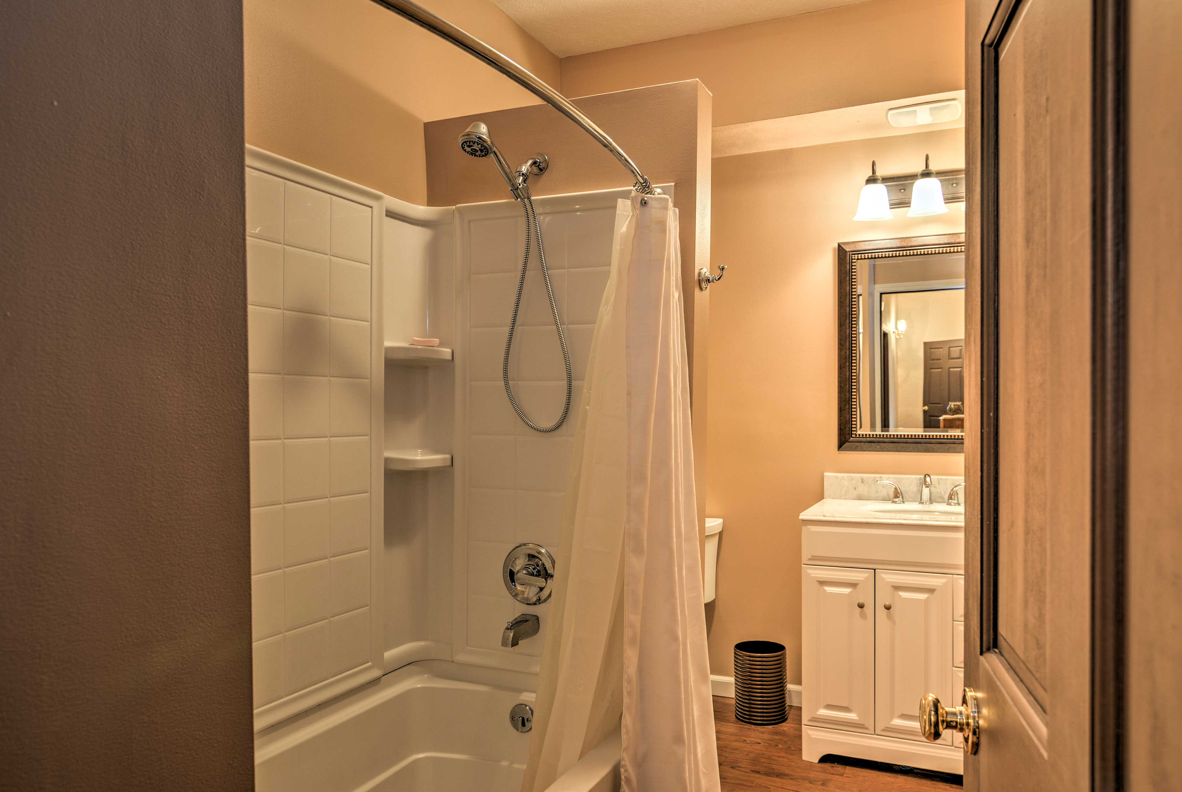 Get ready for the day in the shower/tub combo.