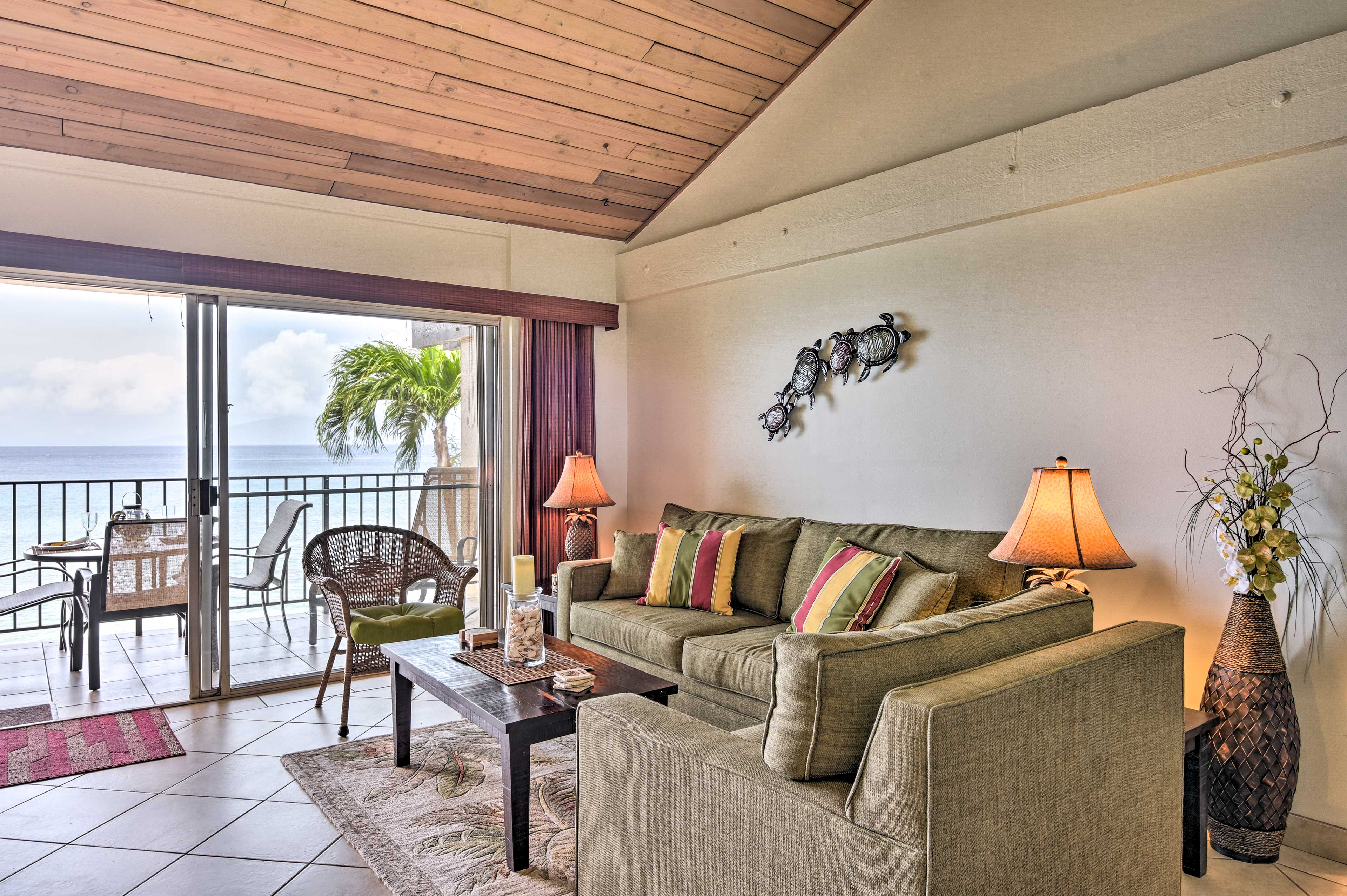 With vaulted ceilings and glass doors to the lanai this space is bright and open.