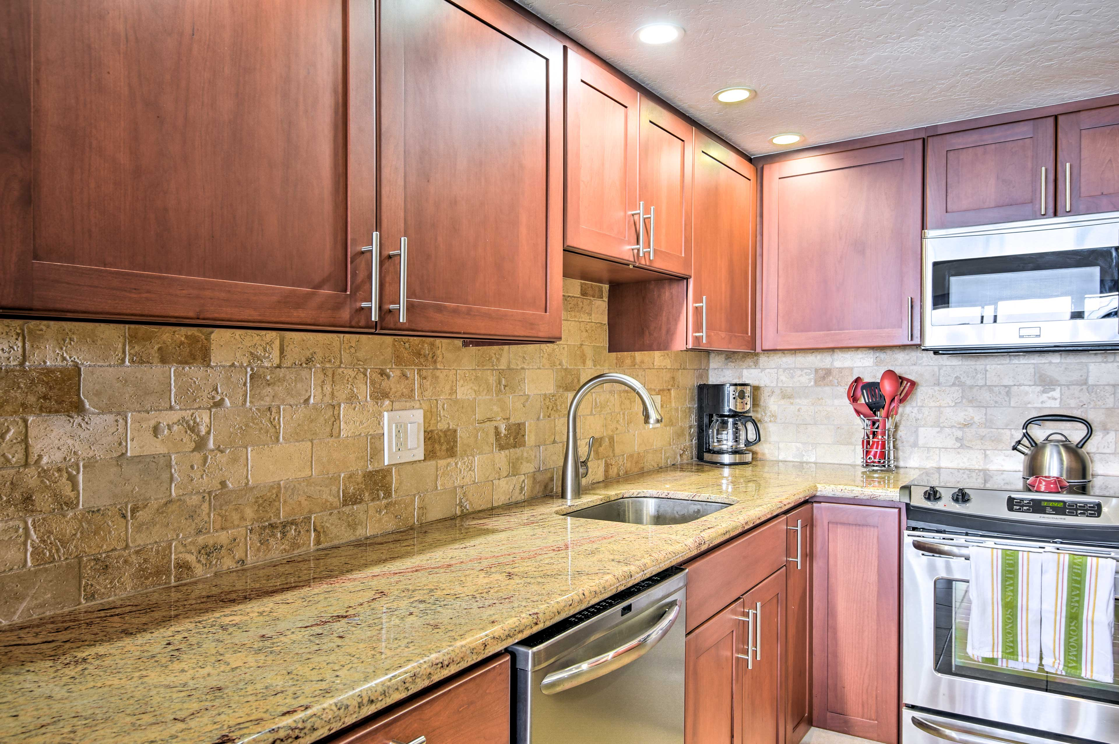 Granite countertops complement the new mahogany cabinets.
