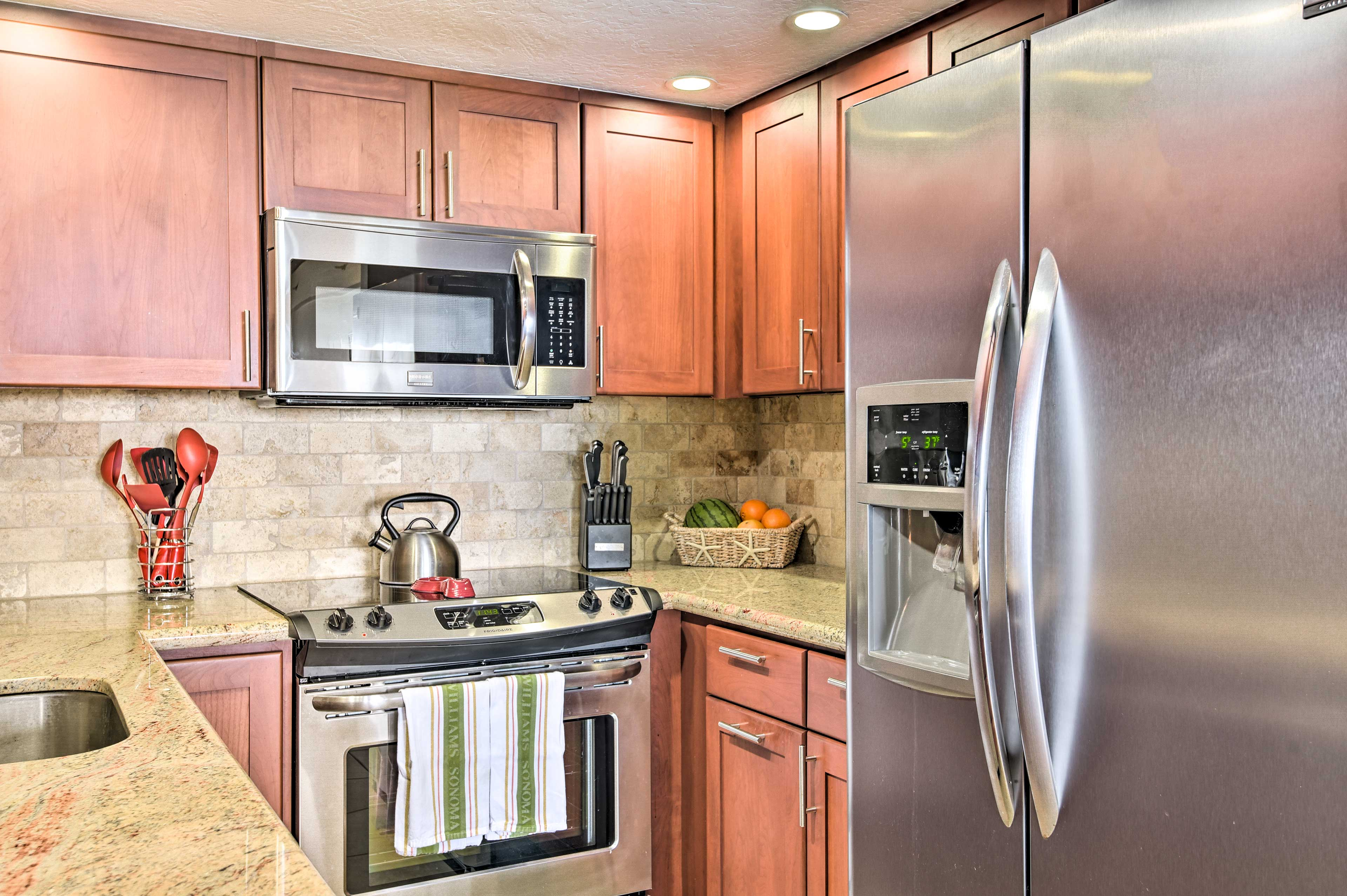 Stainless steel appliances gleam in the fully equipped kitchen.
