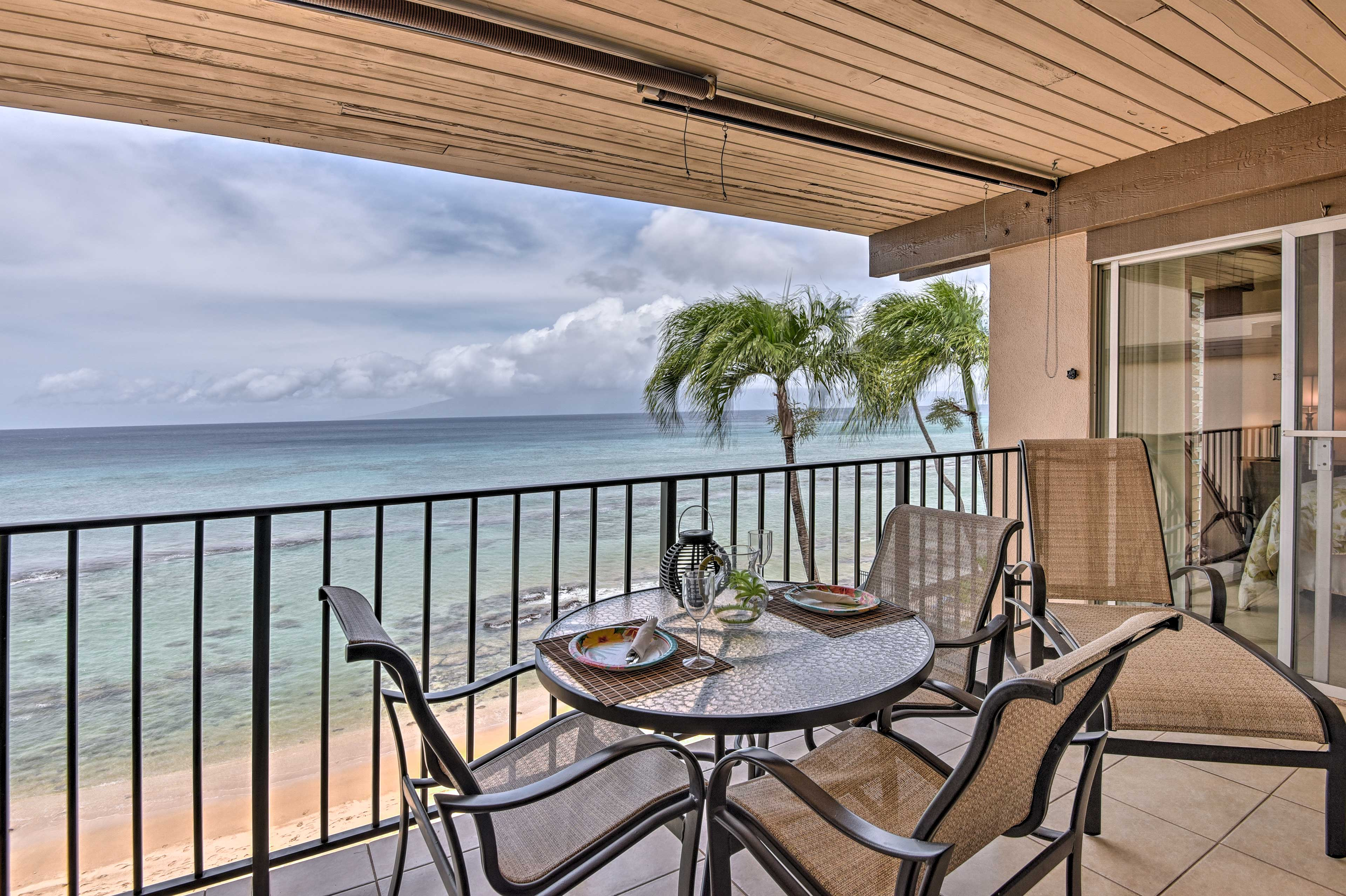 Look out over the ocean from the lanai of your Lahaina vacation rental home.