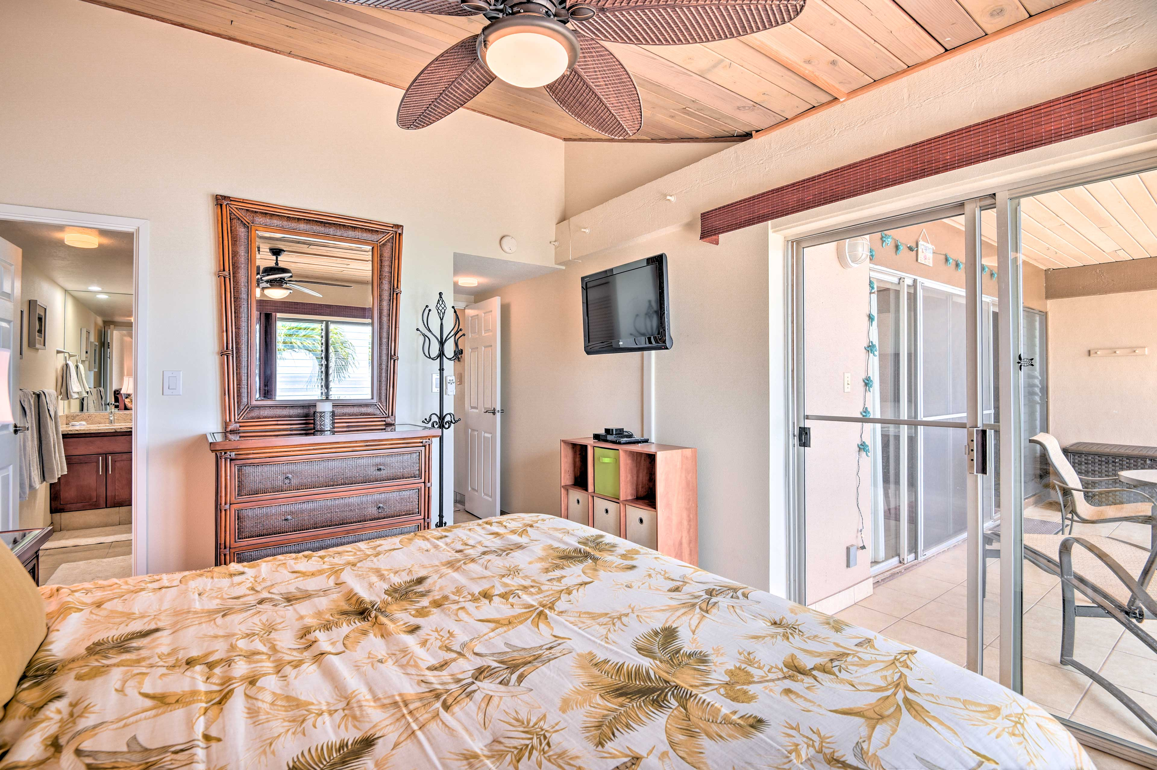Walk out to the covered lanai from the master bedroom.
