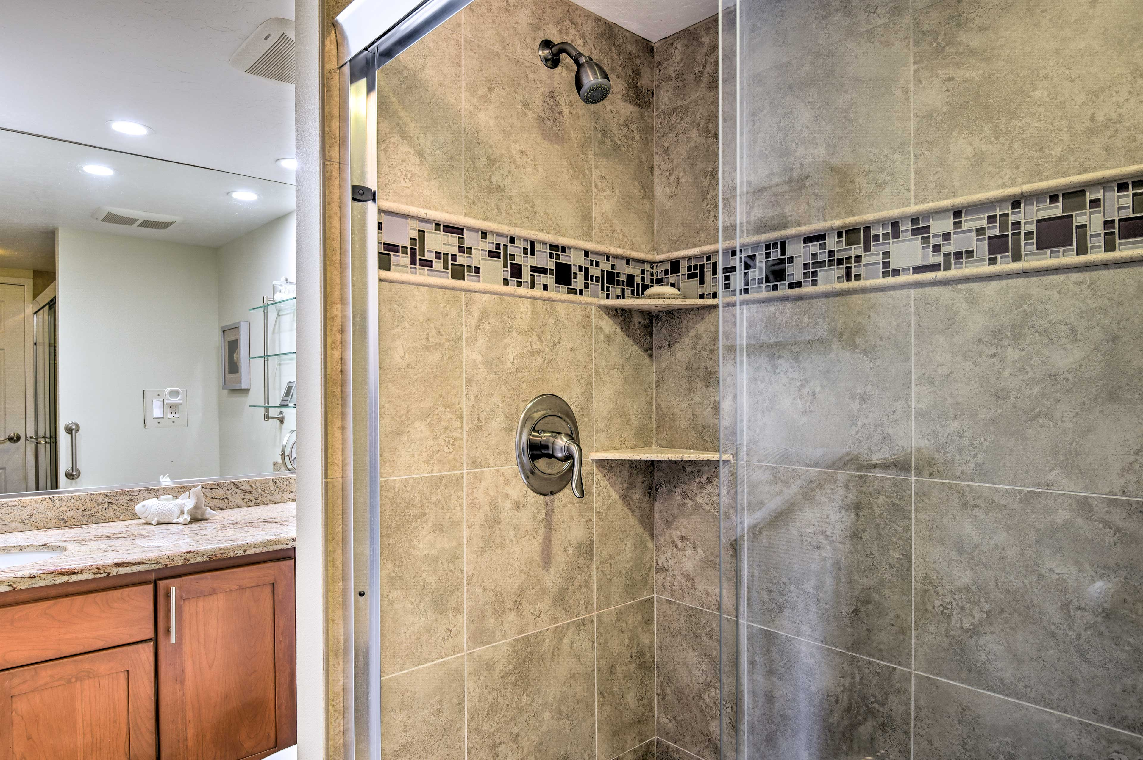 The master en-suite bathroom has a beautifully tiled walk-in shower.