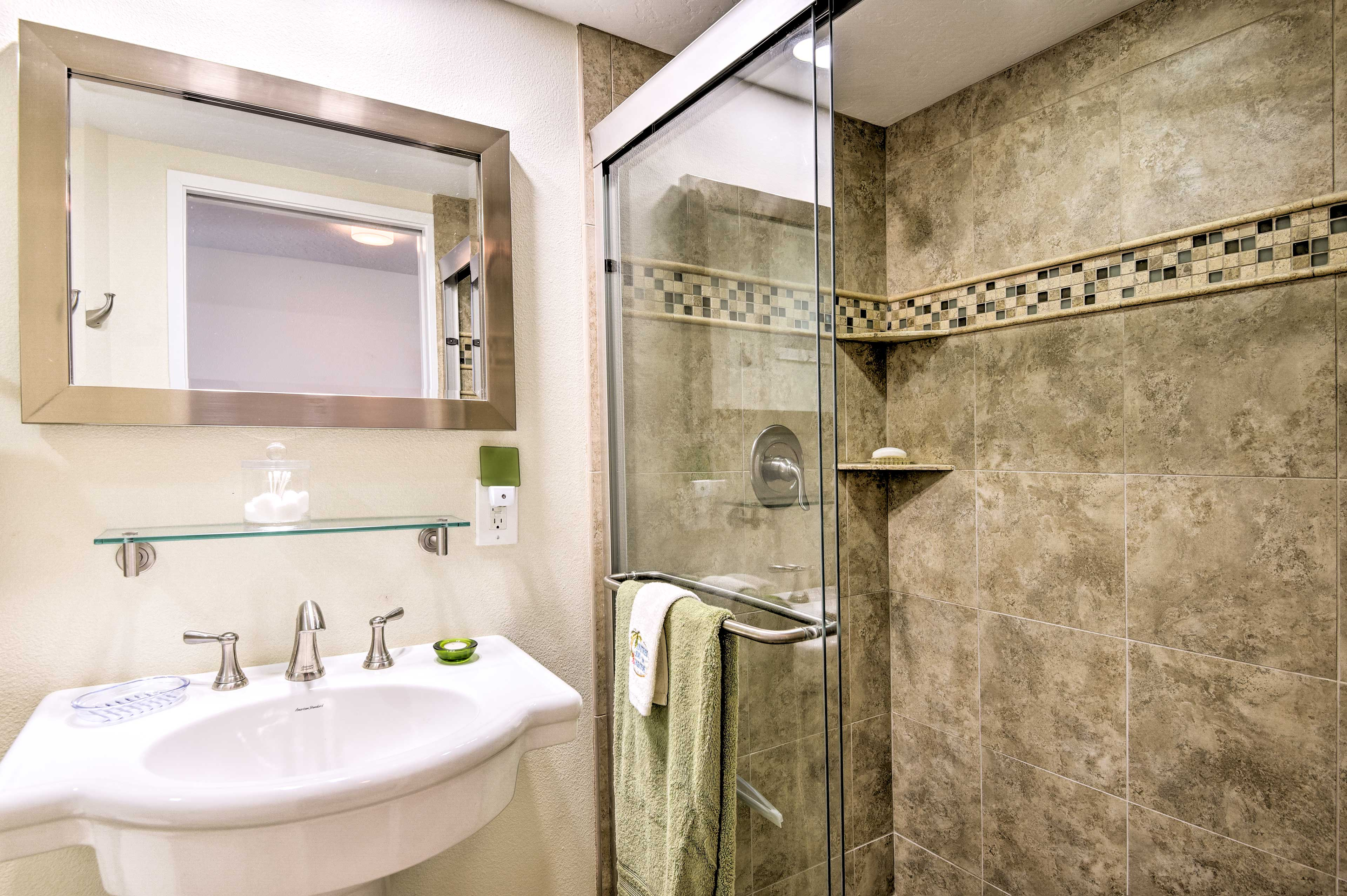 The second bathroom also features an elegant walk-in shower.