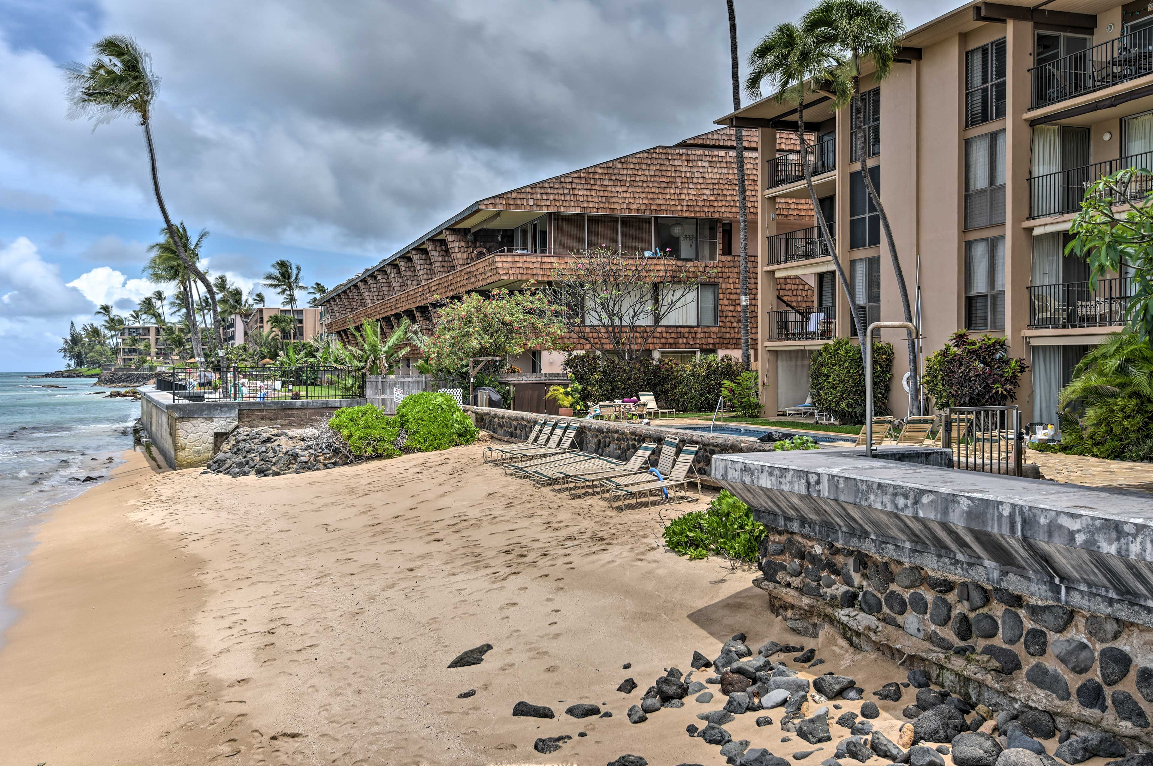 Stroll along the beach, steps from your vacation rental condo.
