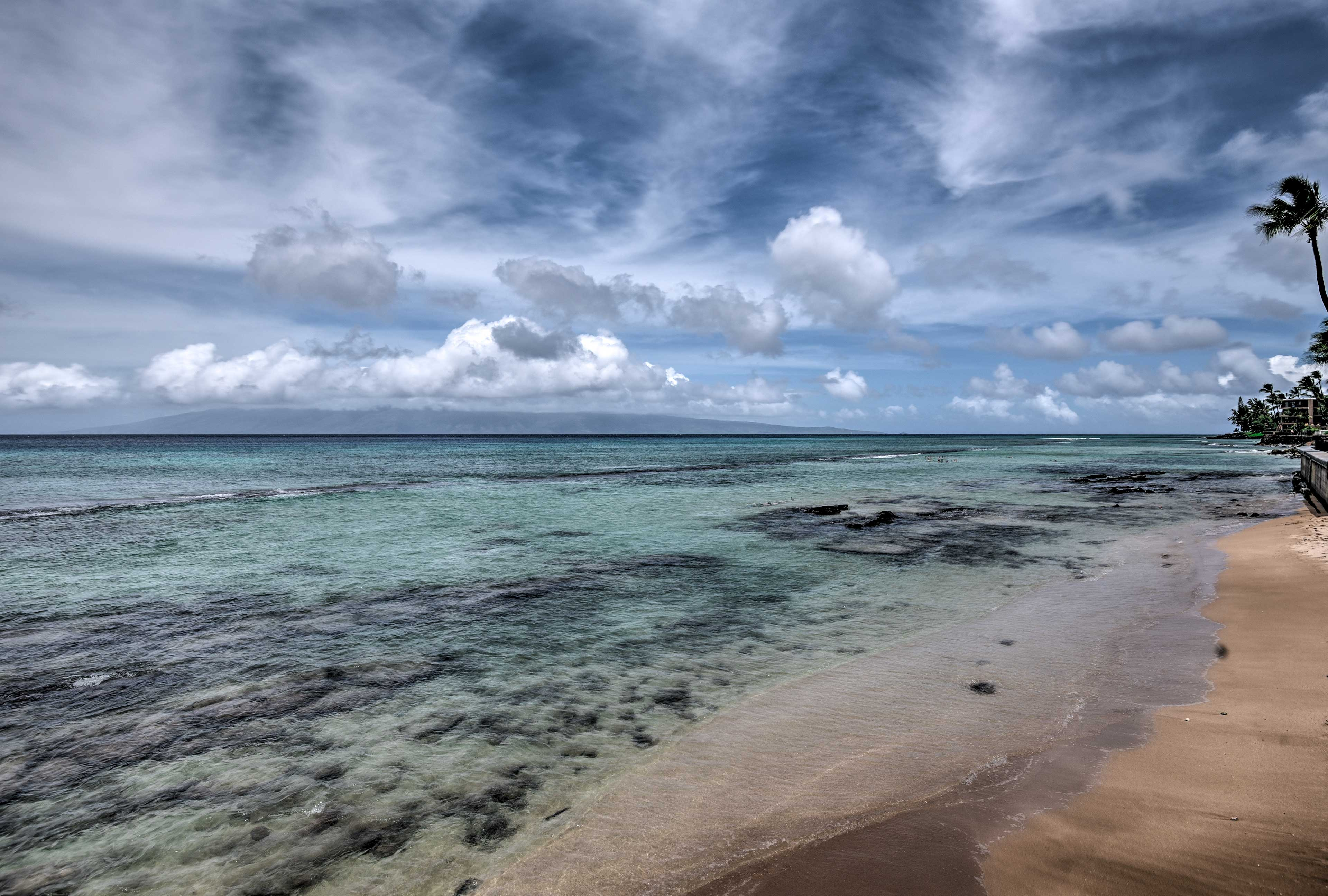 You can see the islands of Lanai and Molokai from your condo!