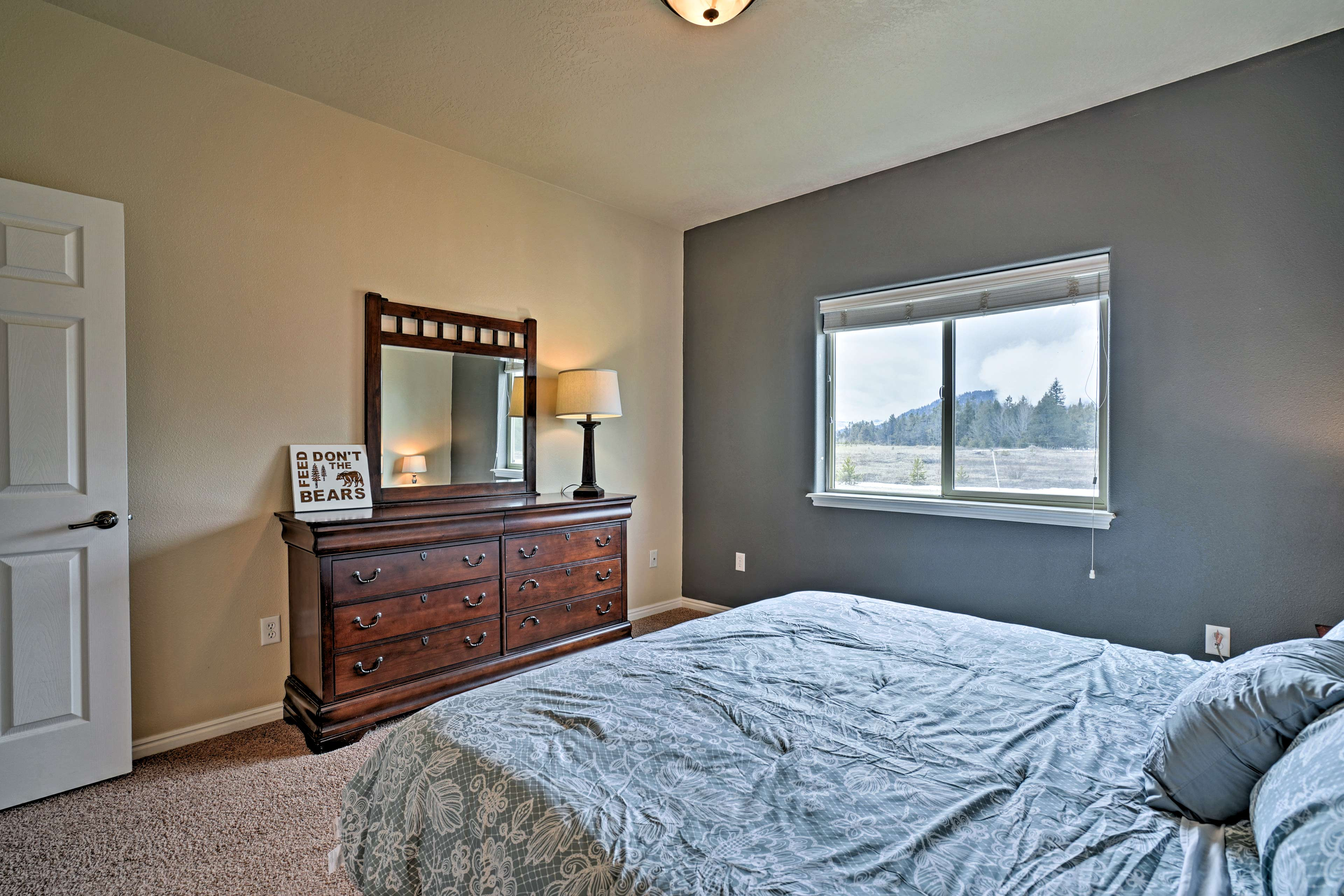 The master bedroom features a lovely king-sized bed.