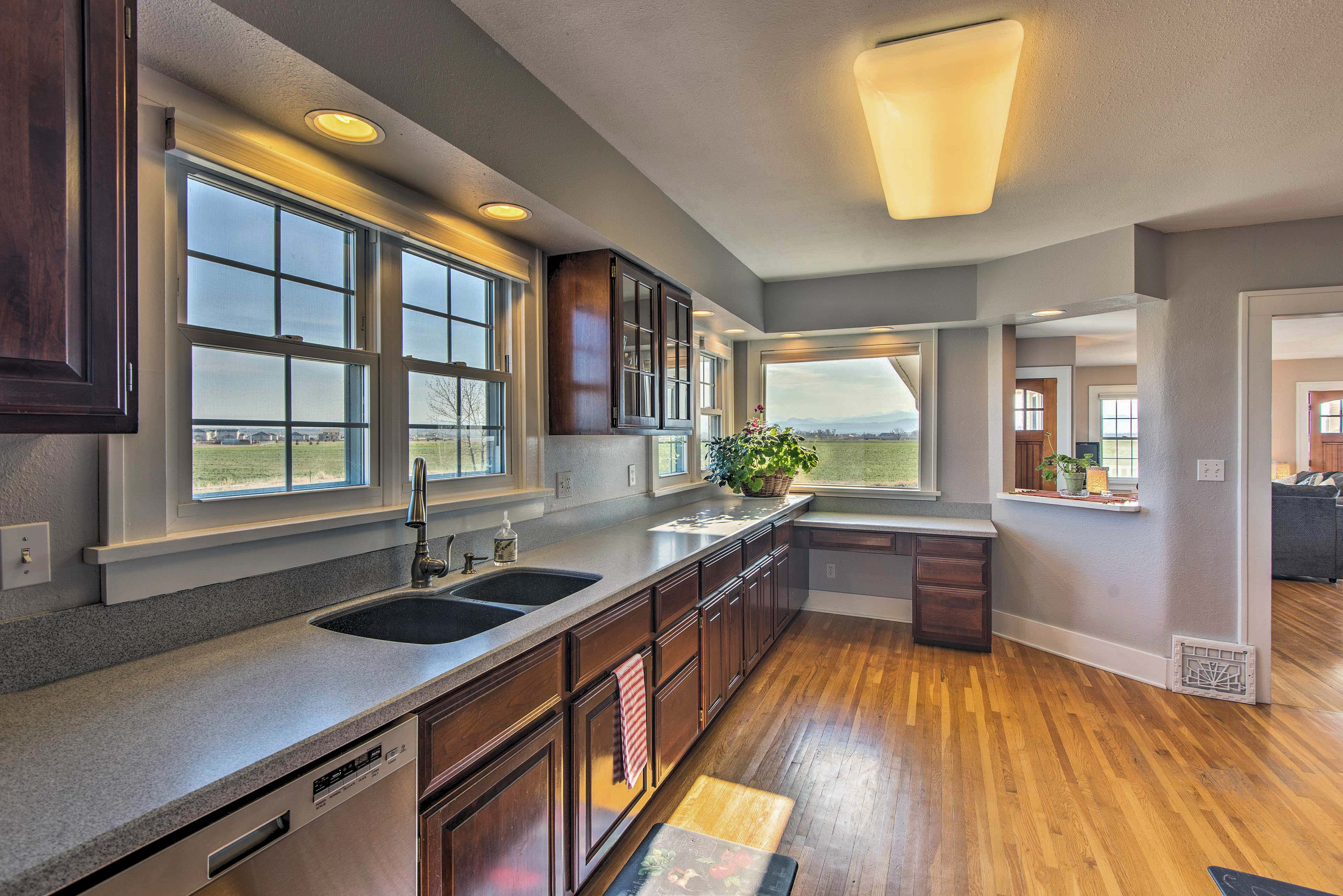 The cooking space includes stainless steel appliances and double sink.