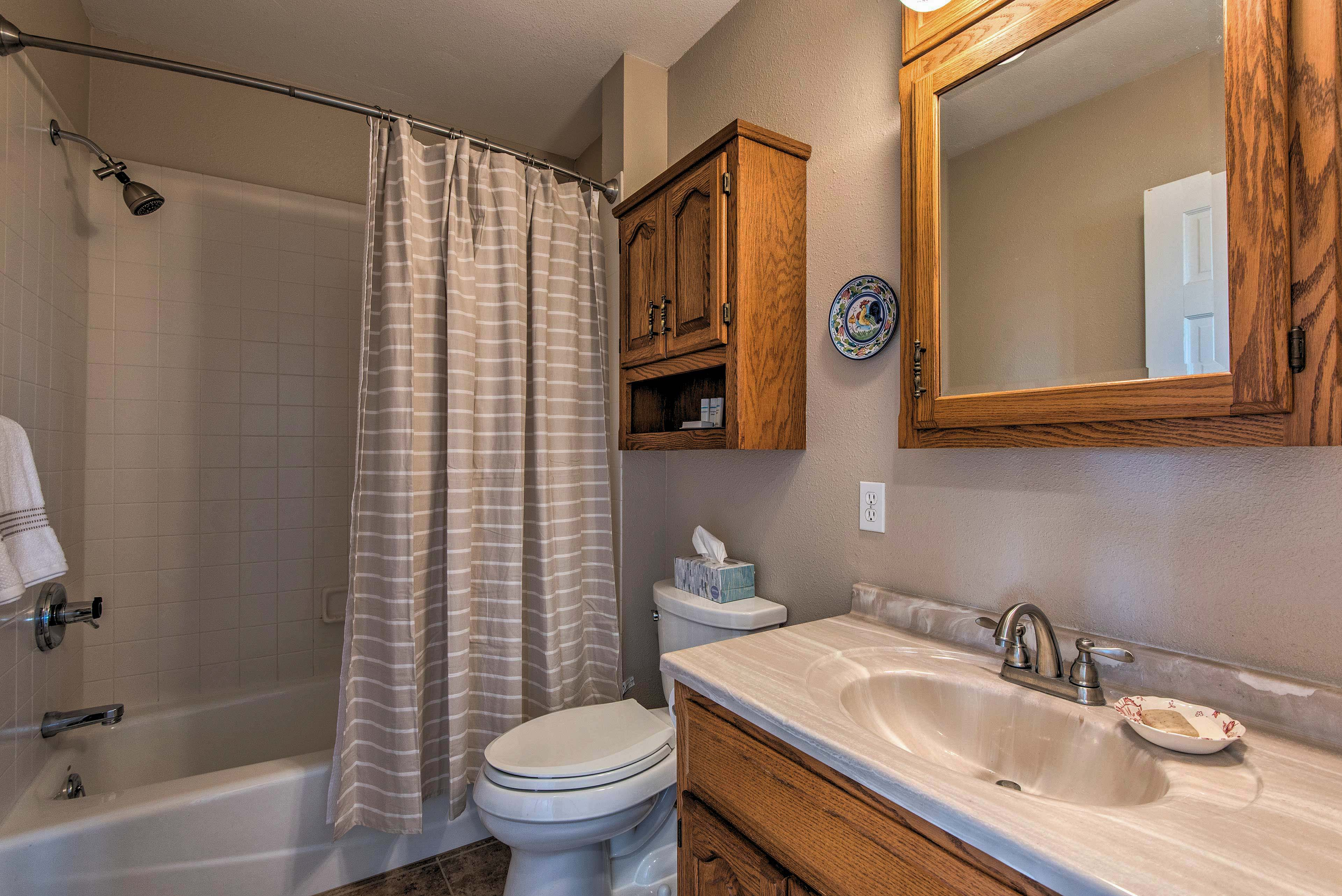 The second bathroom houses a shower/tub combo.