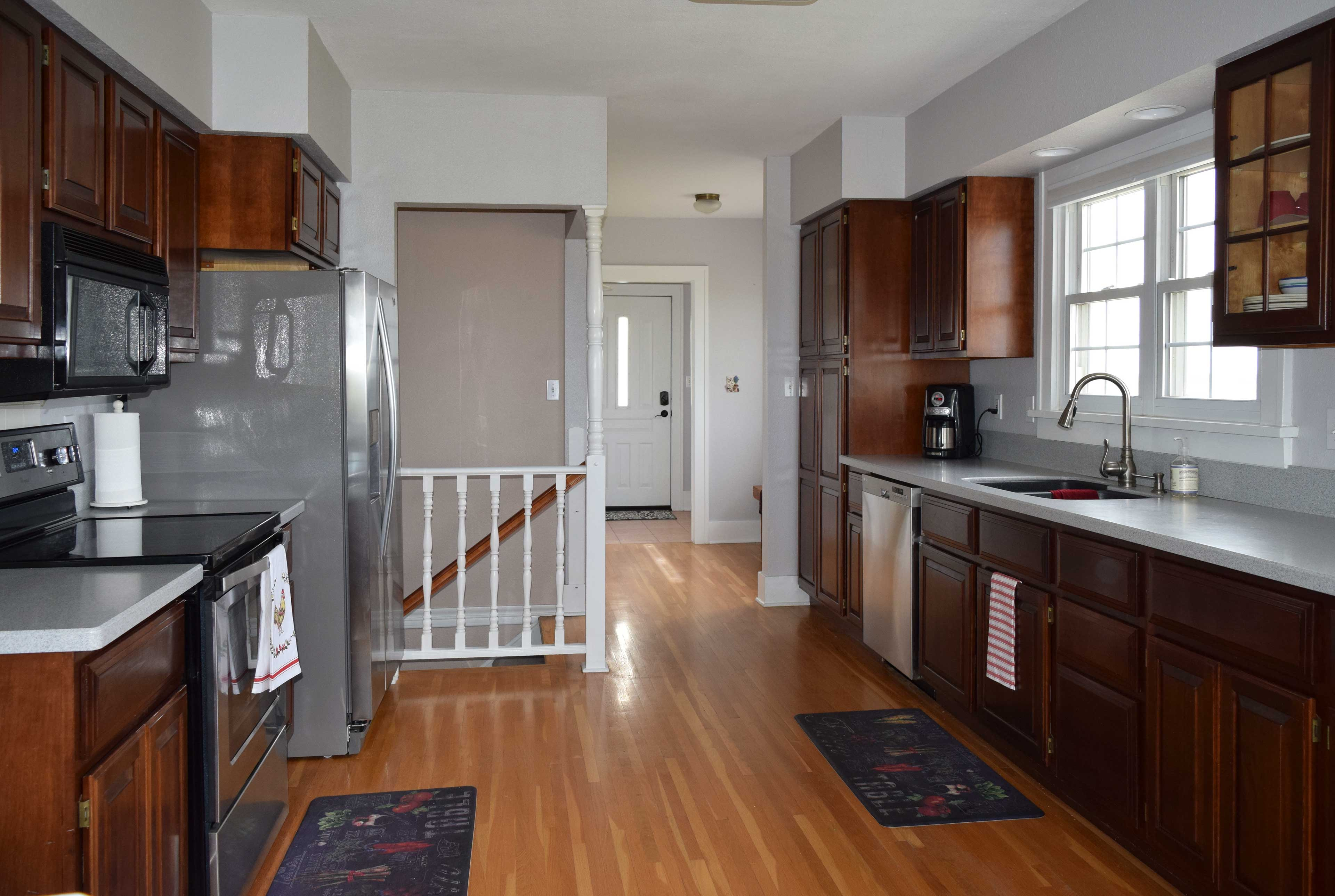 You're sure to adore the pristine, fully equipped kitchen!