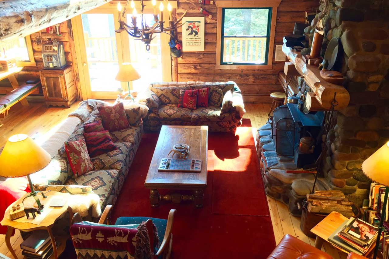 The rustic cabin is ideally located Spoon Lake in the town of Columbia Falls.