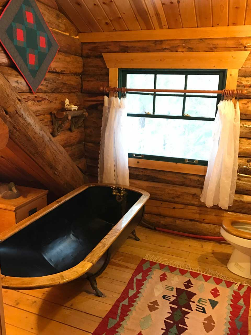 Take a relaxing bath in this antique tub.