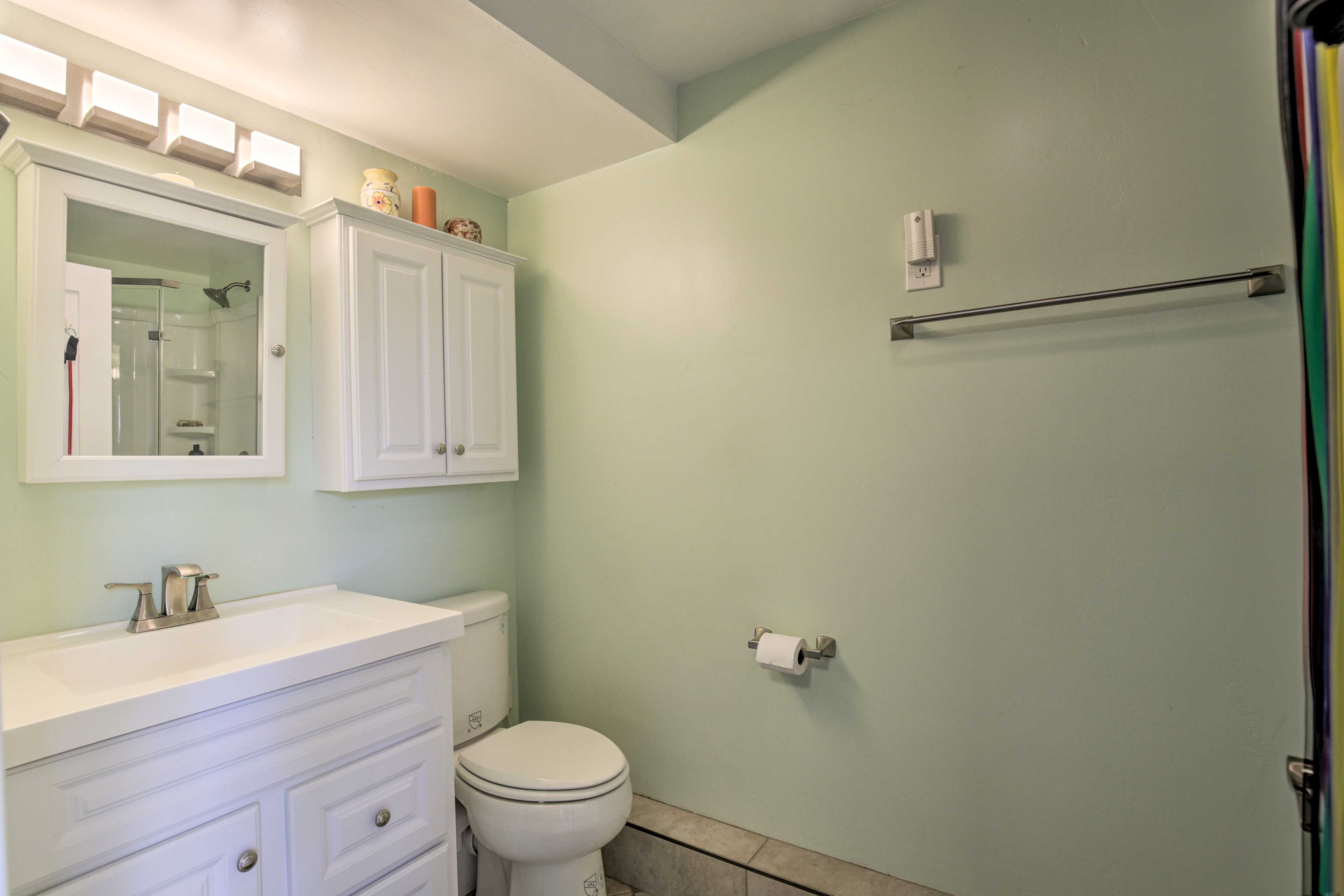 Get ready for the day with ease in the en-suite bathroom.