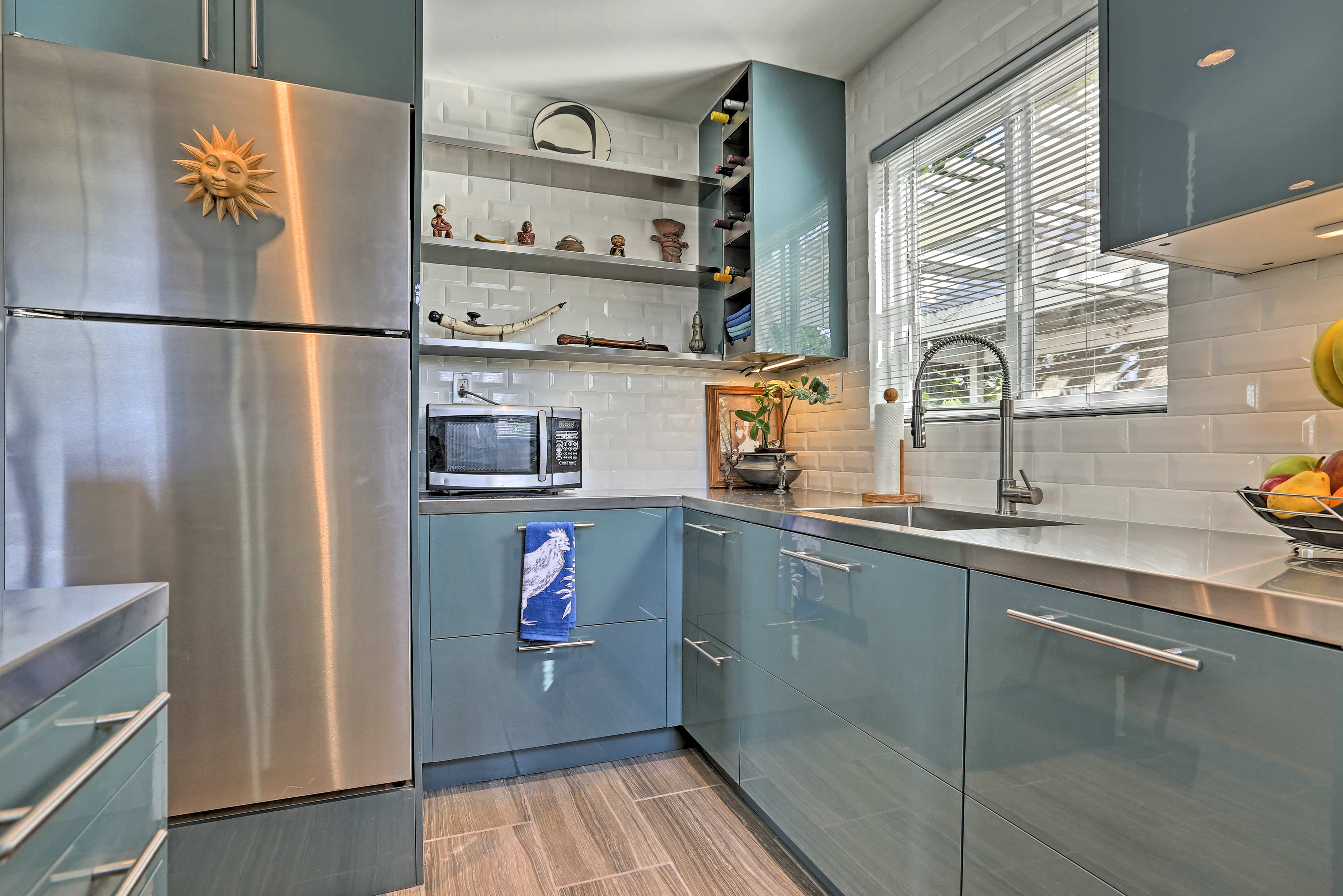 Bold cabinetry acts as the perfect frame for the stainless steel appliances.
