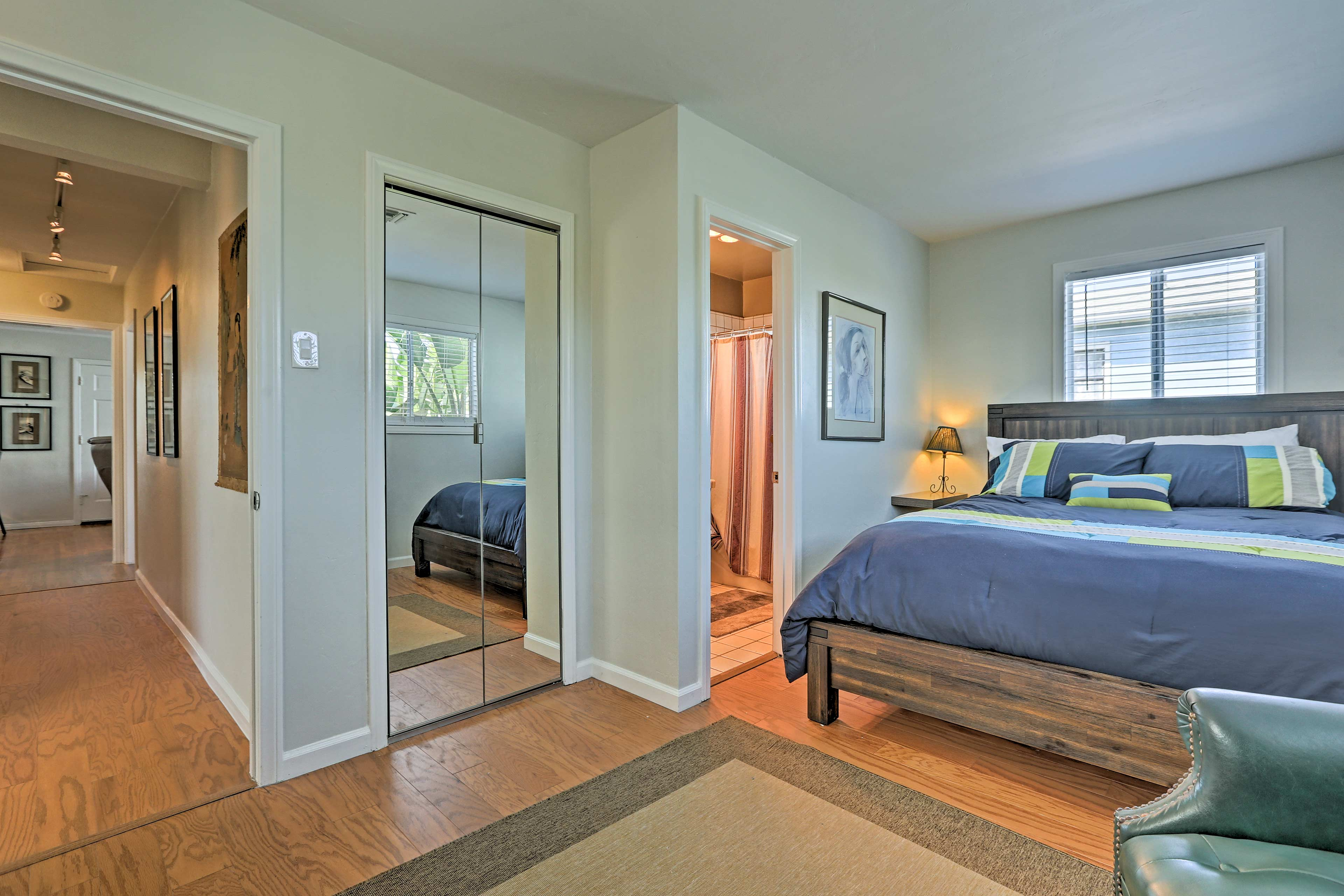 The master bedroom features a cozy queen bed and flat-screen Smart/cable TV.