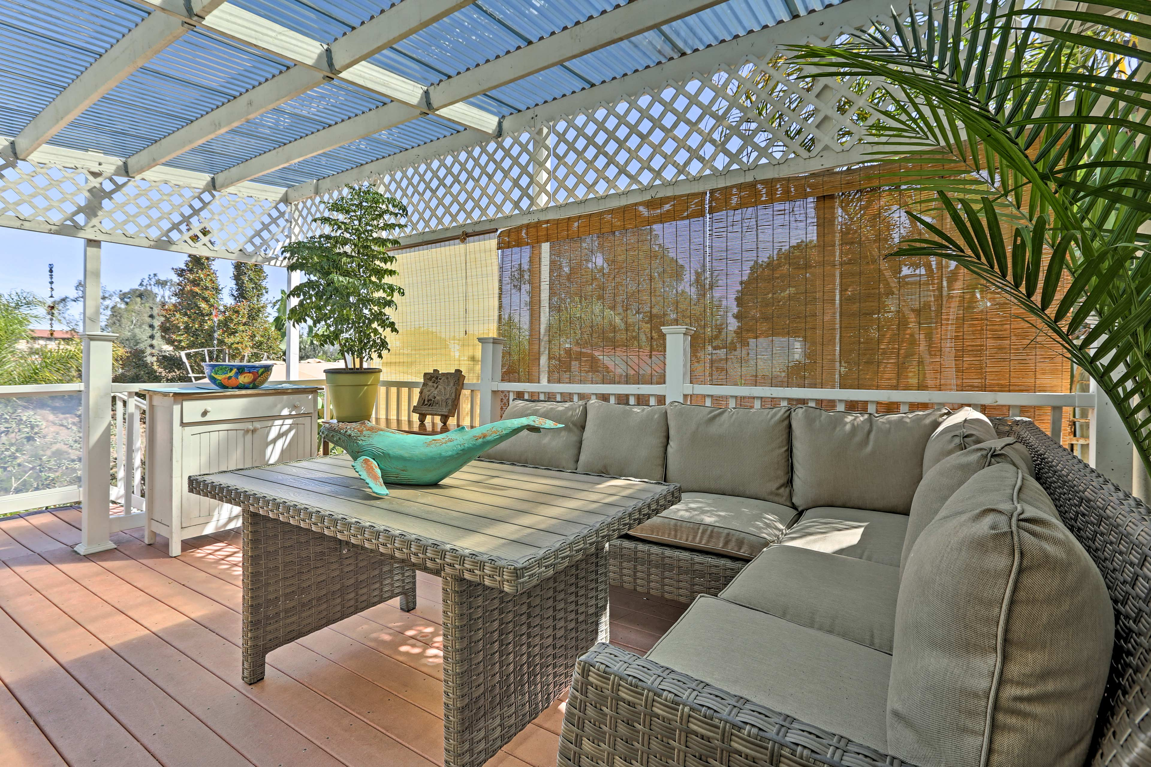 Spend evenings relaxing on the covered porch, with comfortable outdoor seating.