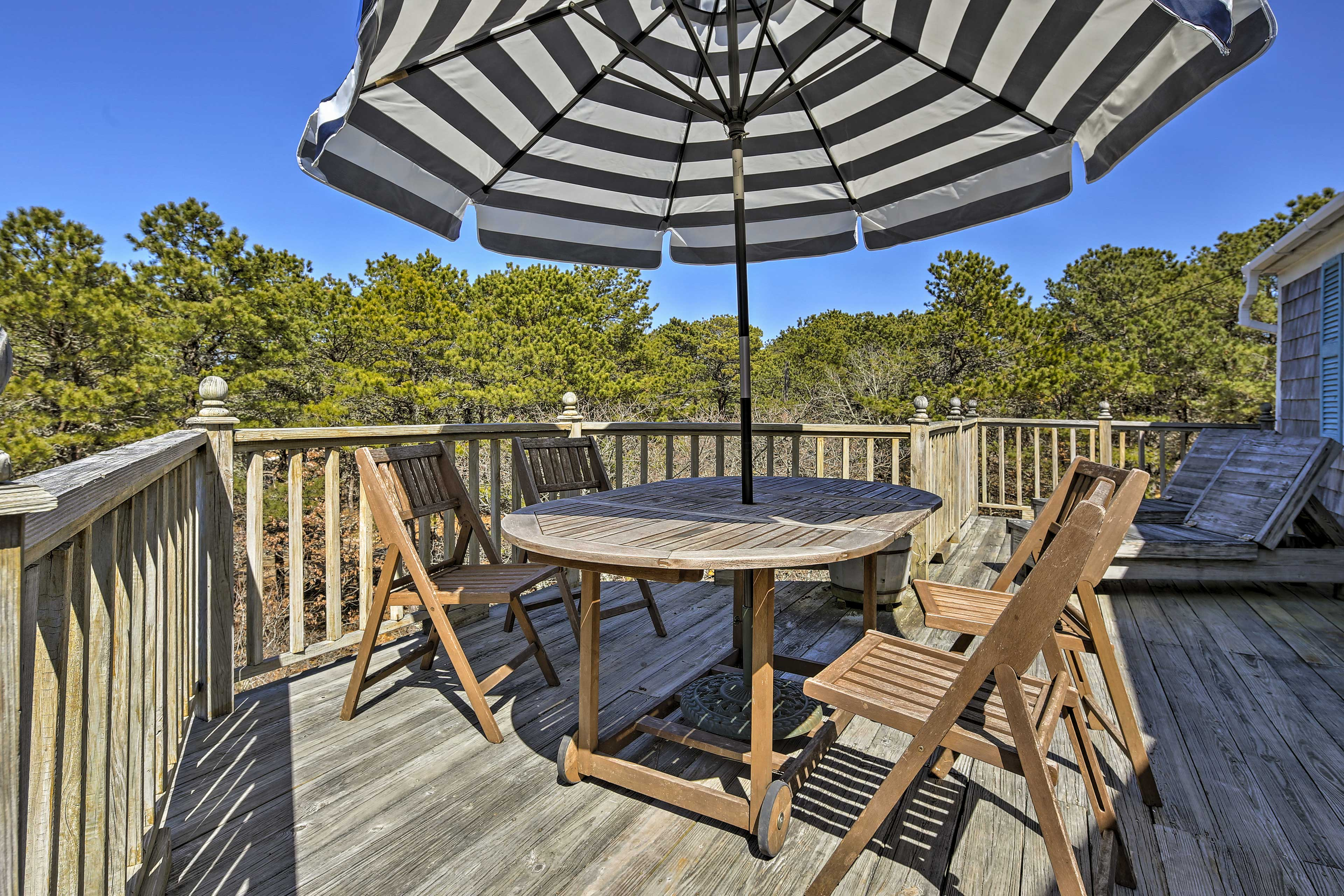 This charming vacation rental cottage sits on 1 acre of private land.
