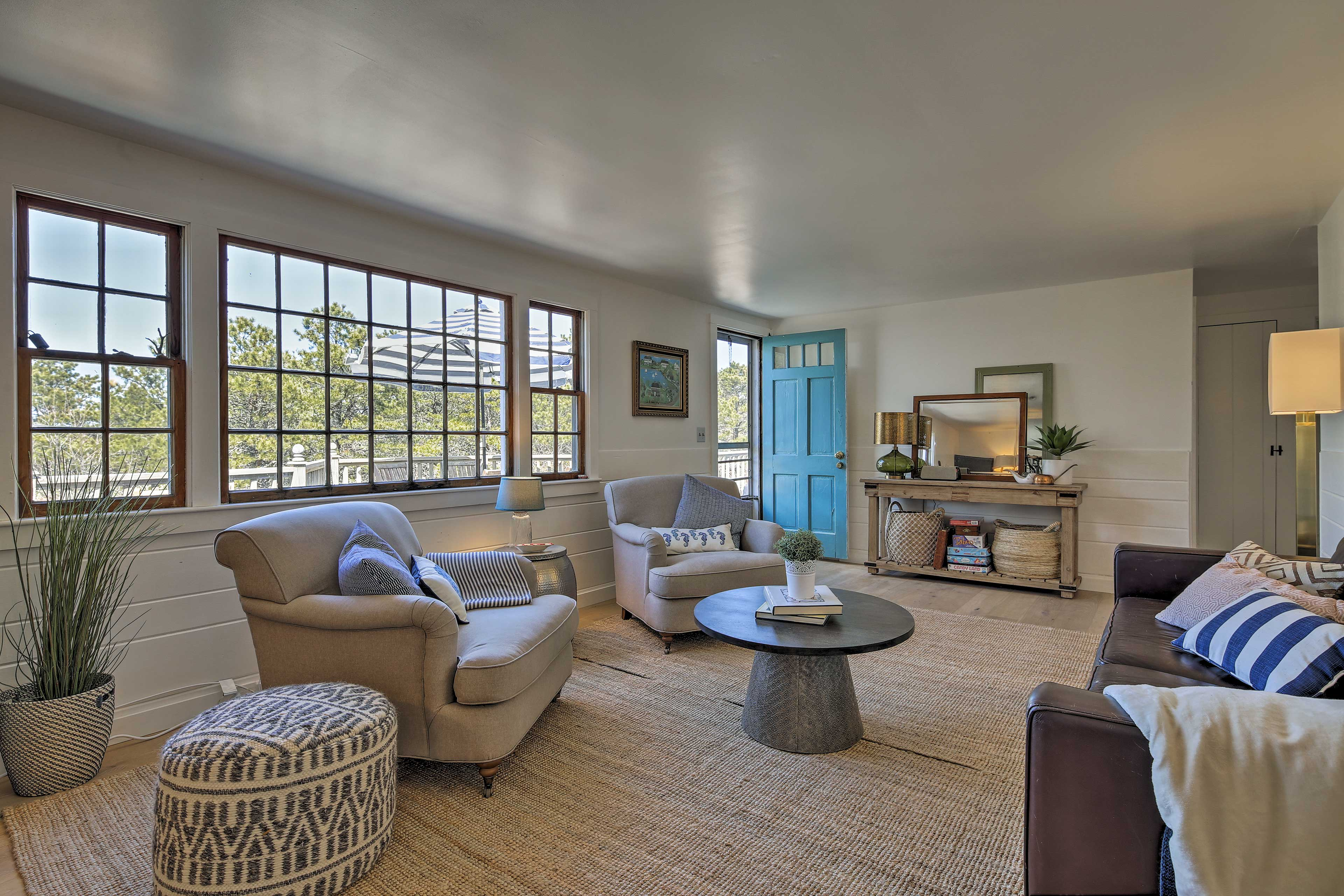 Large picture windows flood the living area with natural light.
