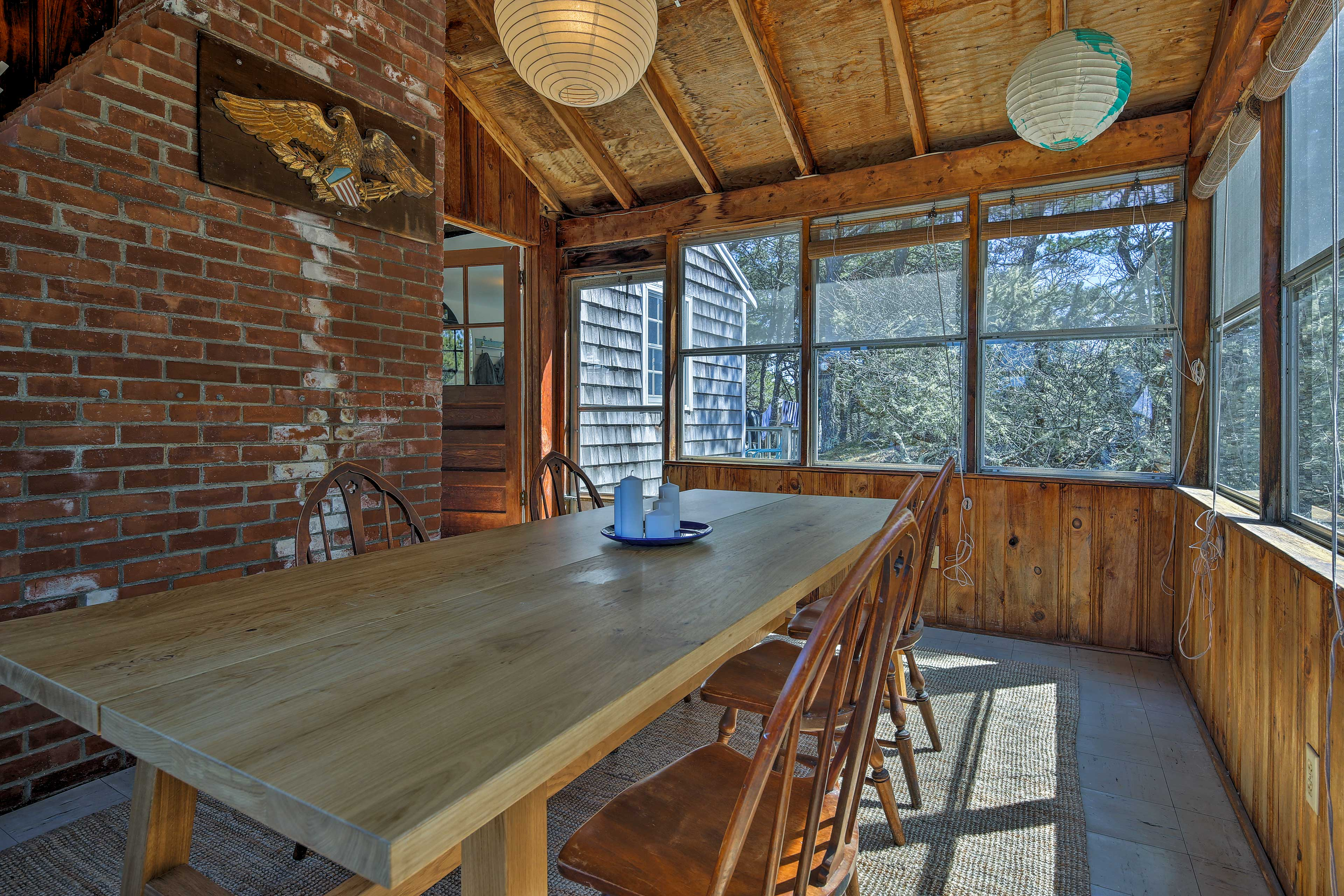 Enjoy family dinners out on the screened porch.