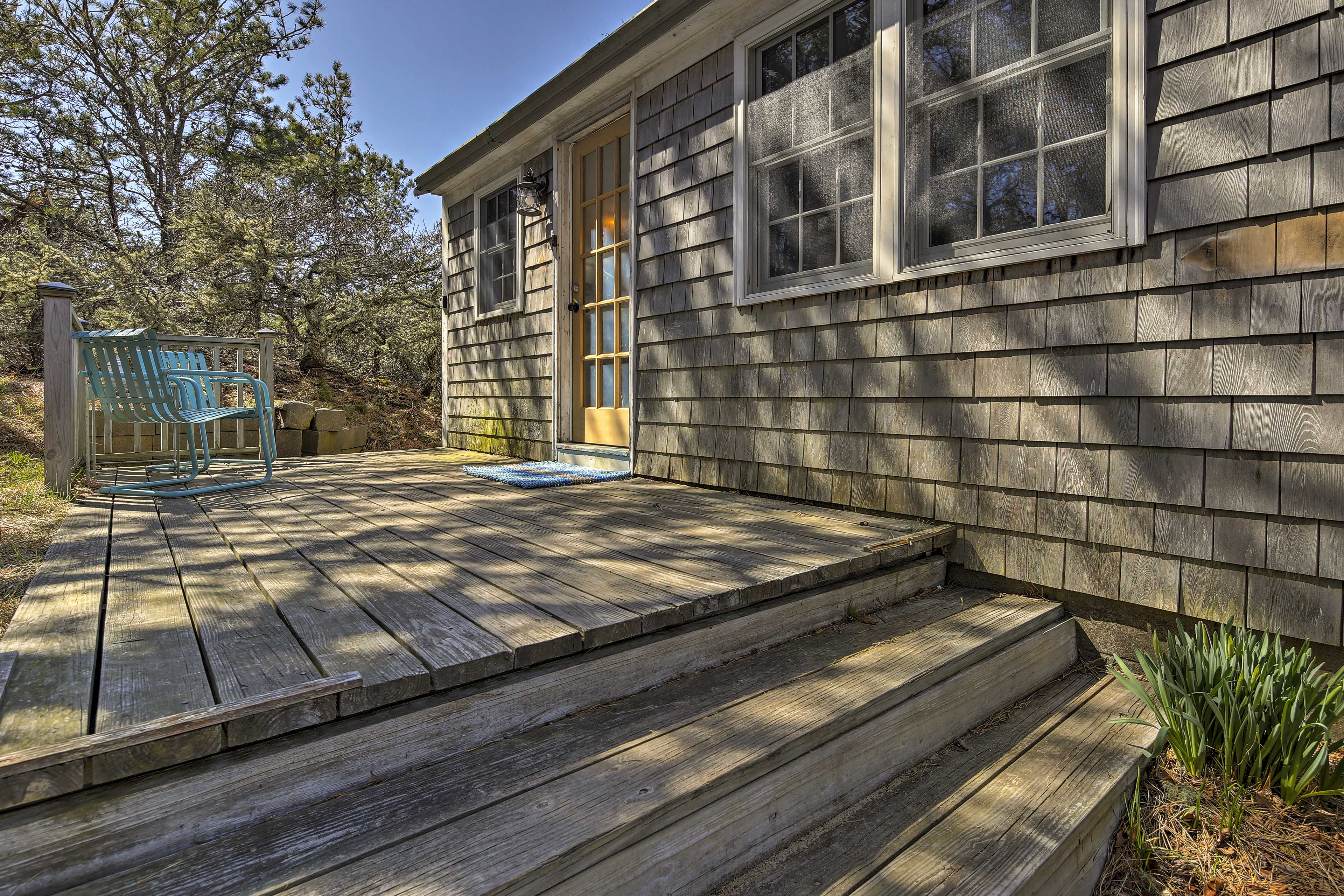 Perched atop a hill, this Eastham cottage affords plenty of peace and privacy.