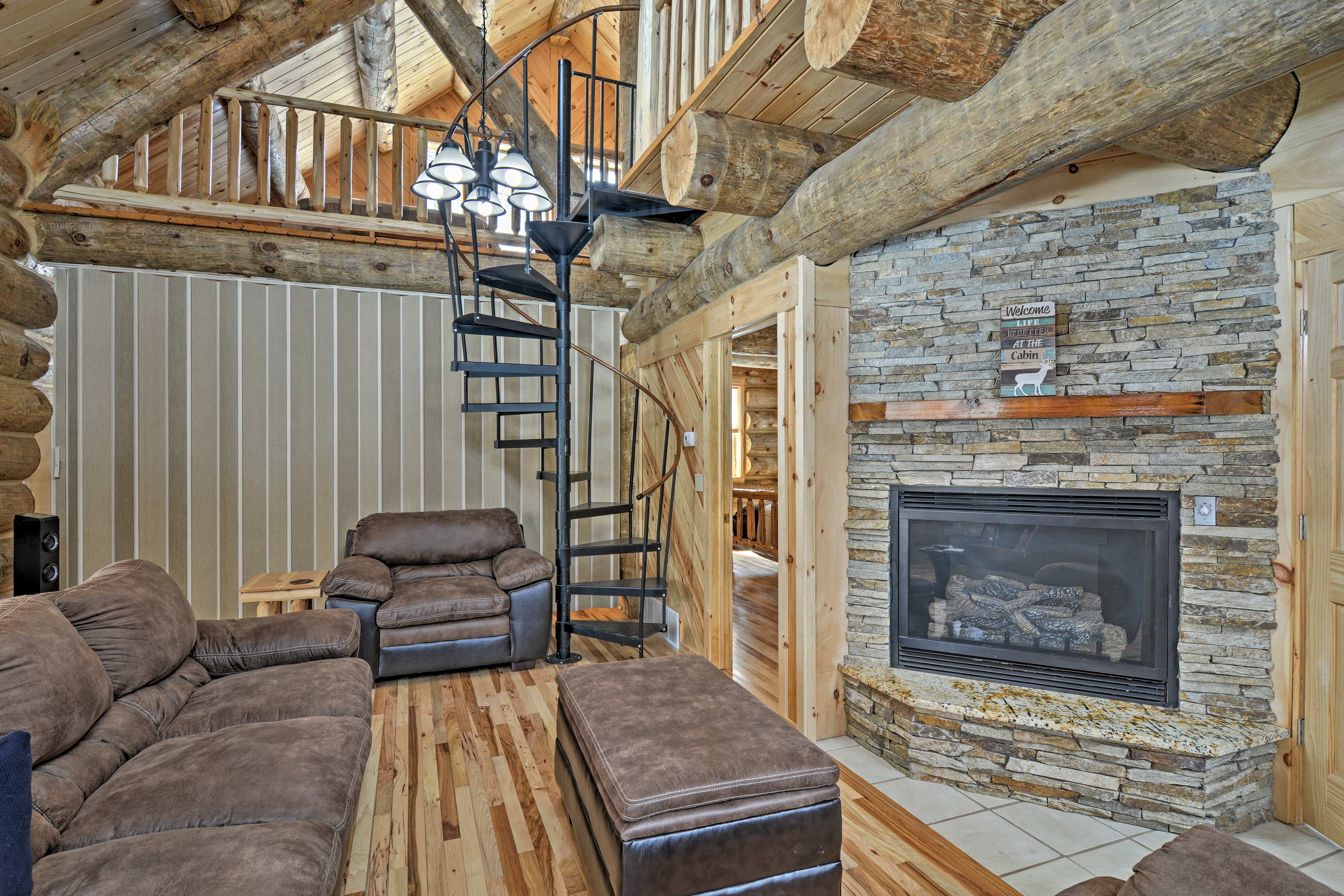 A gorgeous stone gas fireplace highlights the living room.