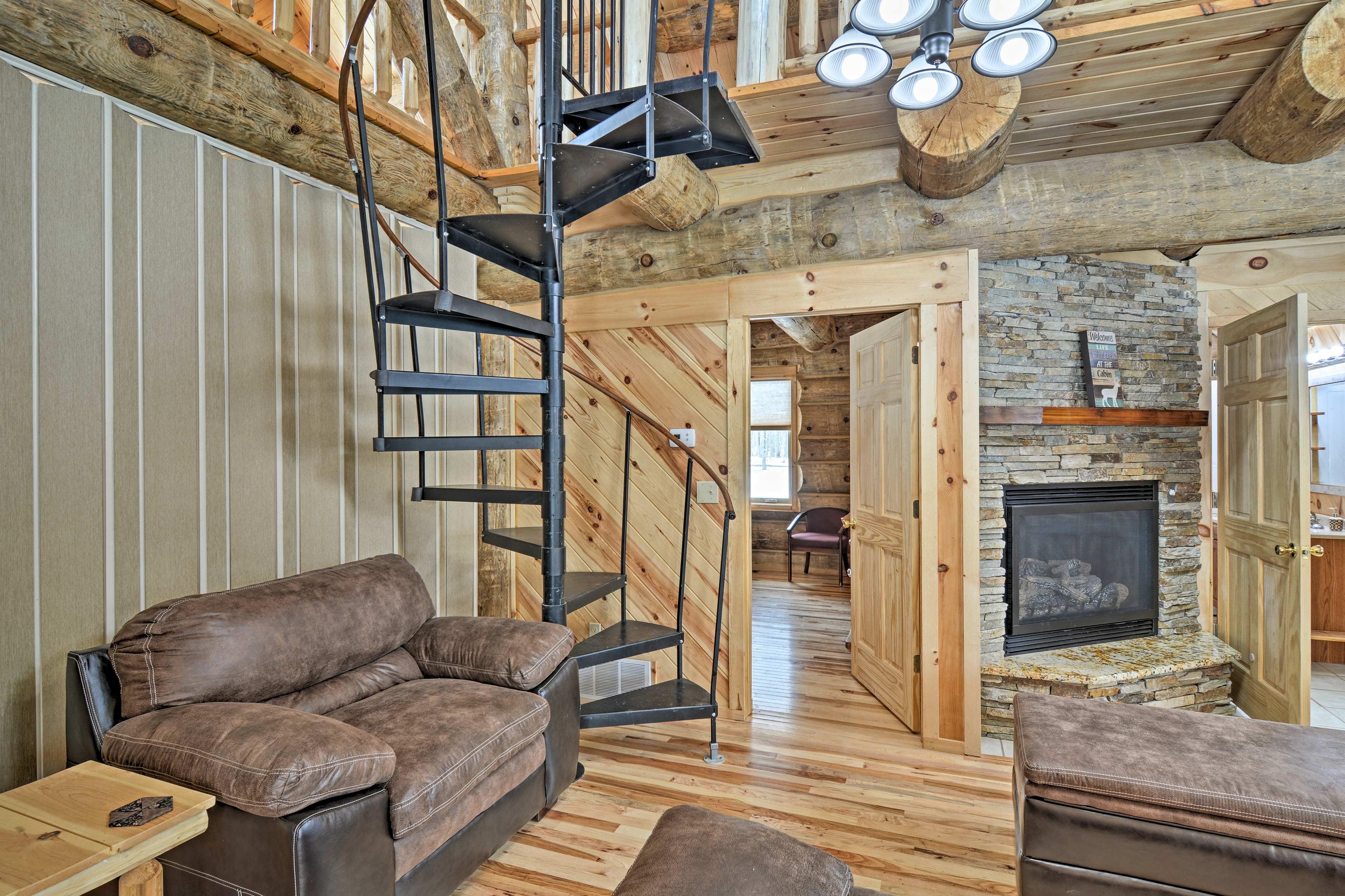 Hardwood floors and log walls exude rustic charm.