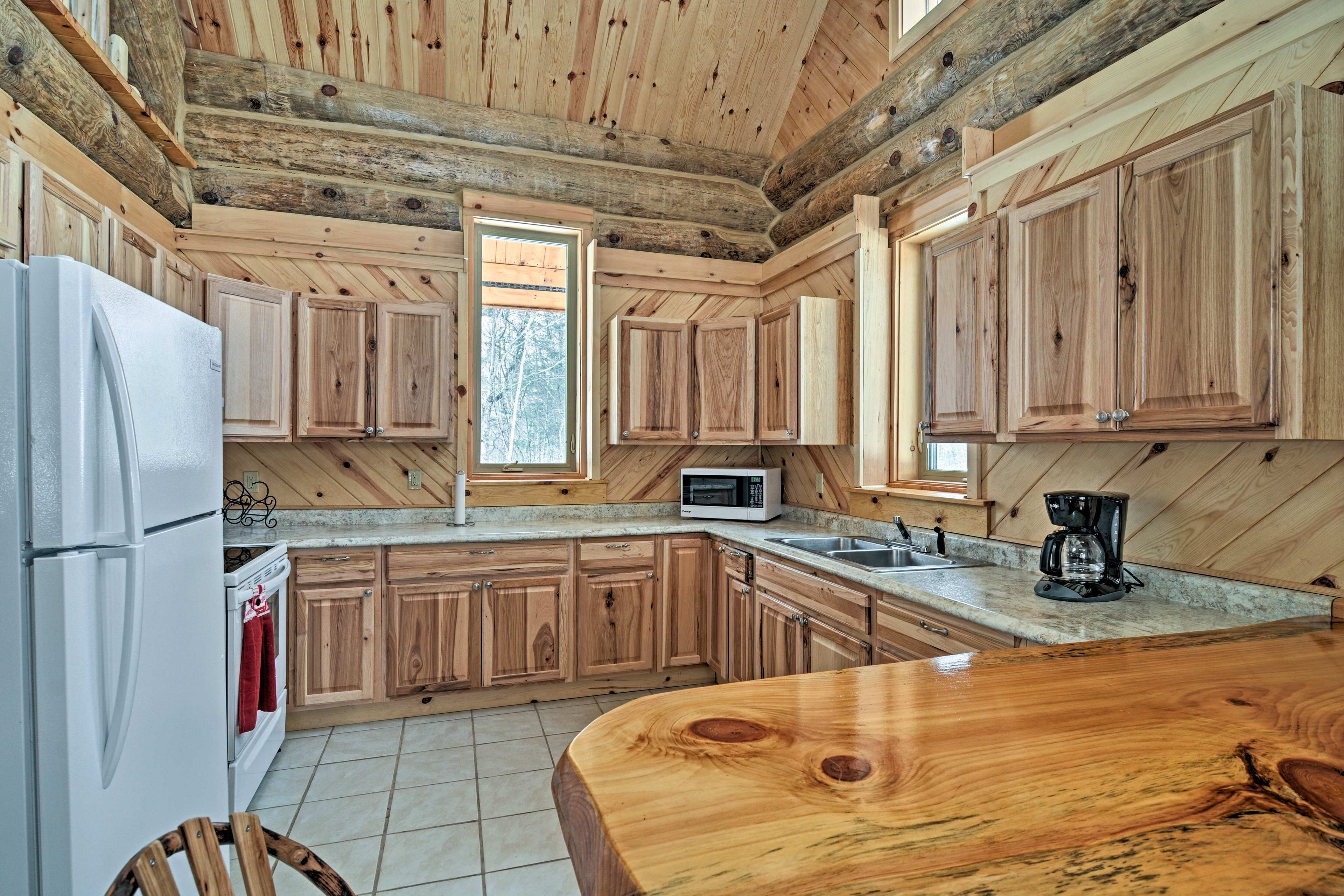 The well-equipped kitchen boasts wood cabinetry and ample counter space.