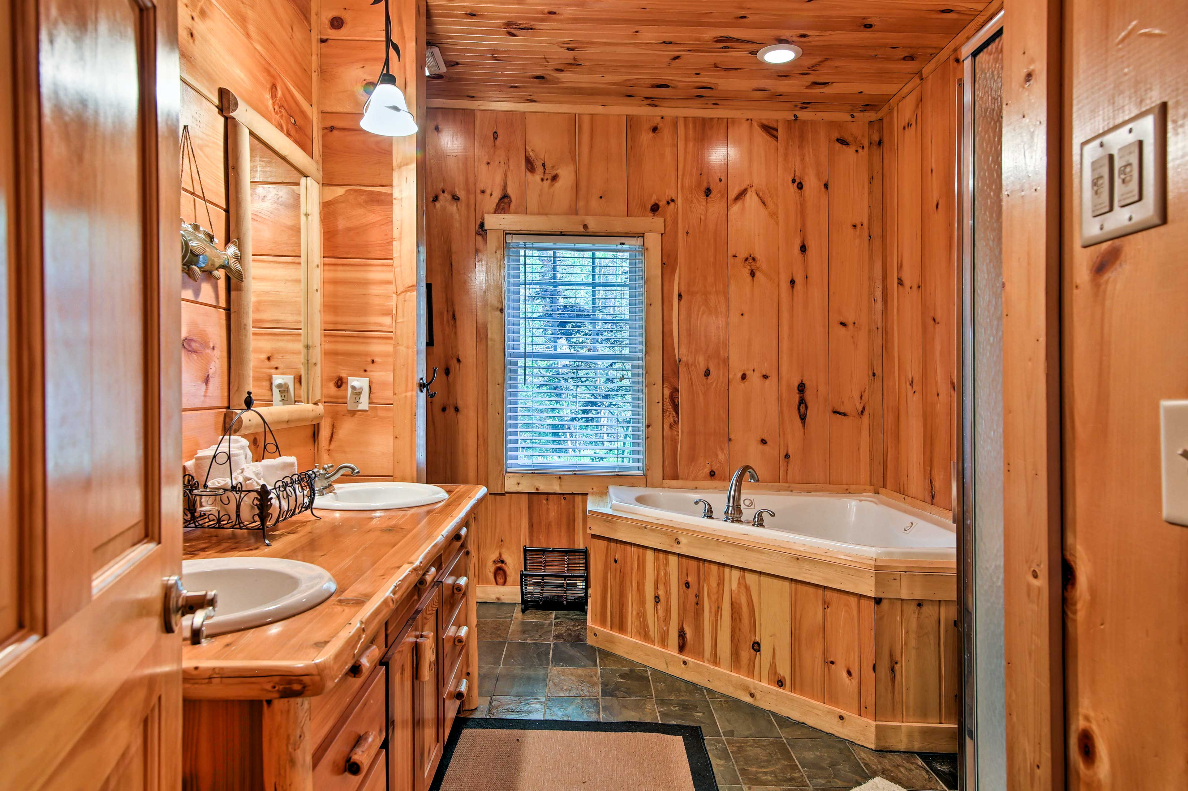 Take a relaxing soak in the master bathroom's Jacuzzi tub.