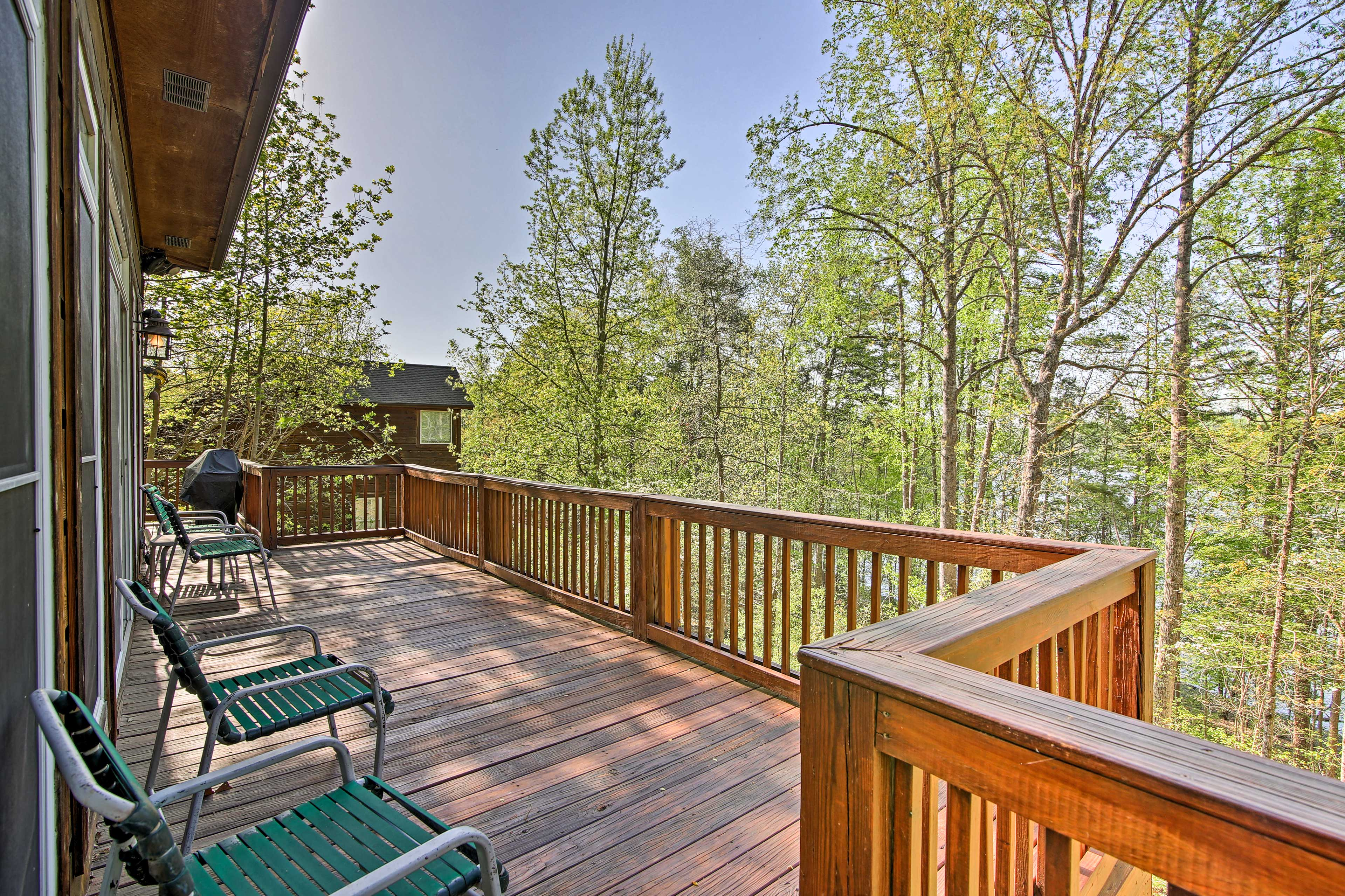 The wraparound deck provides panoramic views of the rich landscape surrounding.