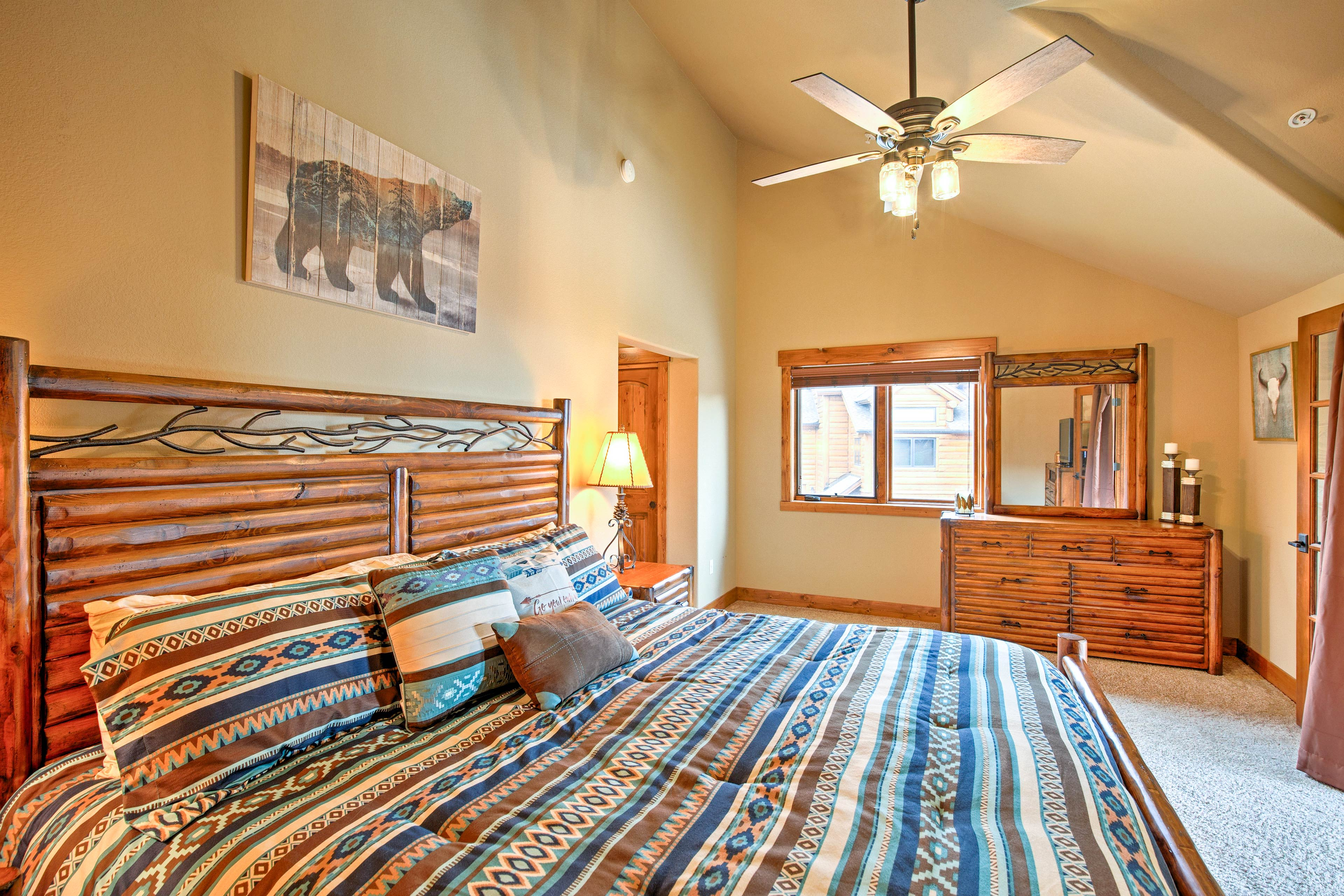 A spacious master bedroom has a cloud-like king bed calling your name.