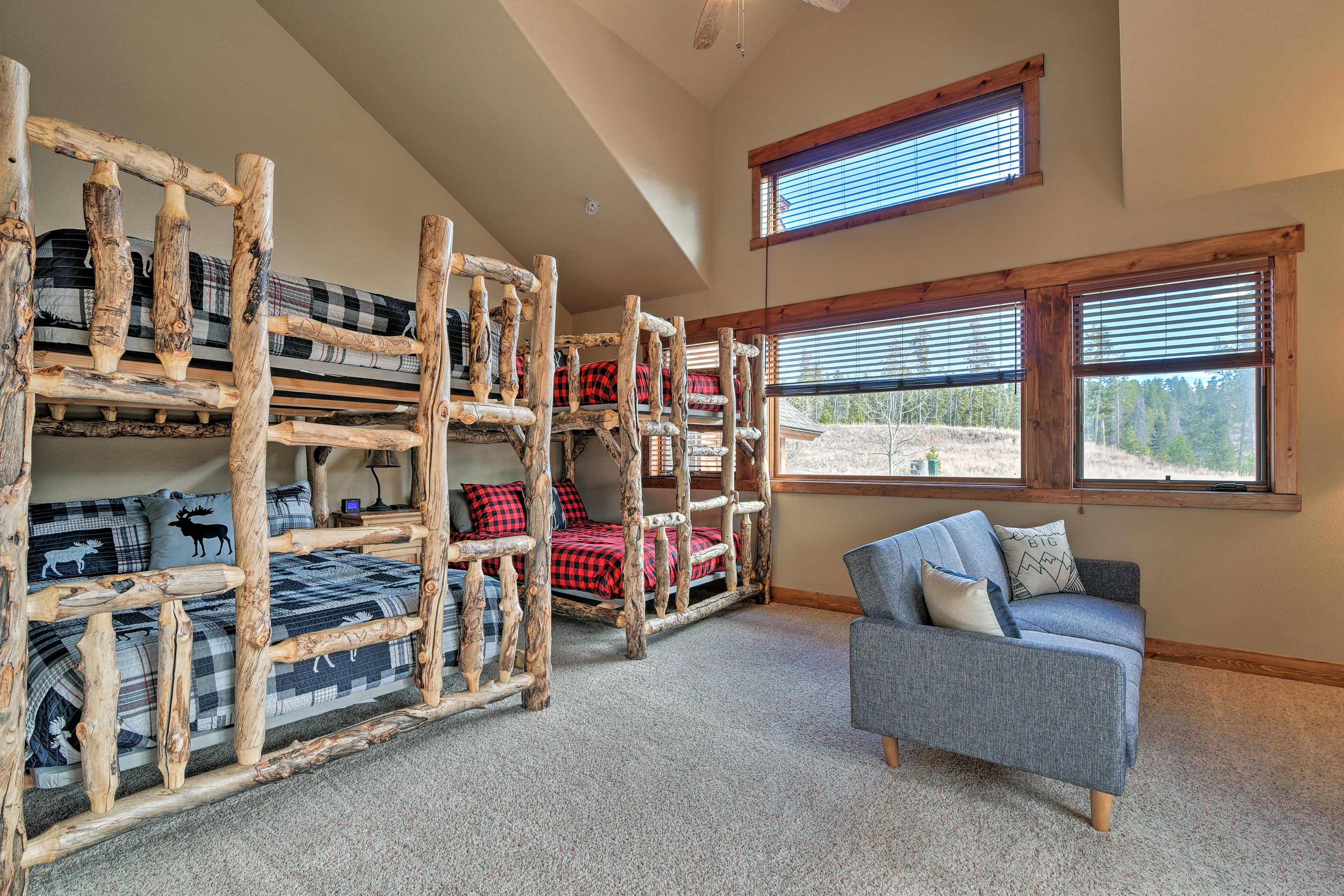 This room features full-over-queen and queen-over-queen adult bunk beds.